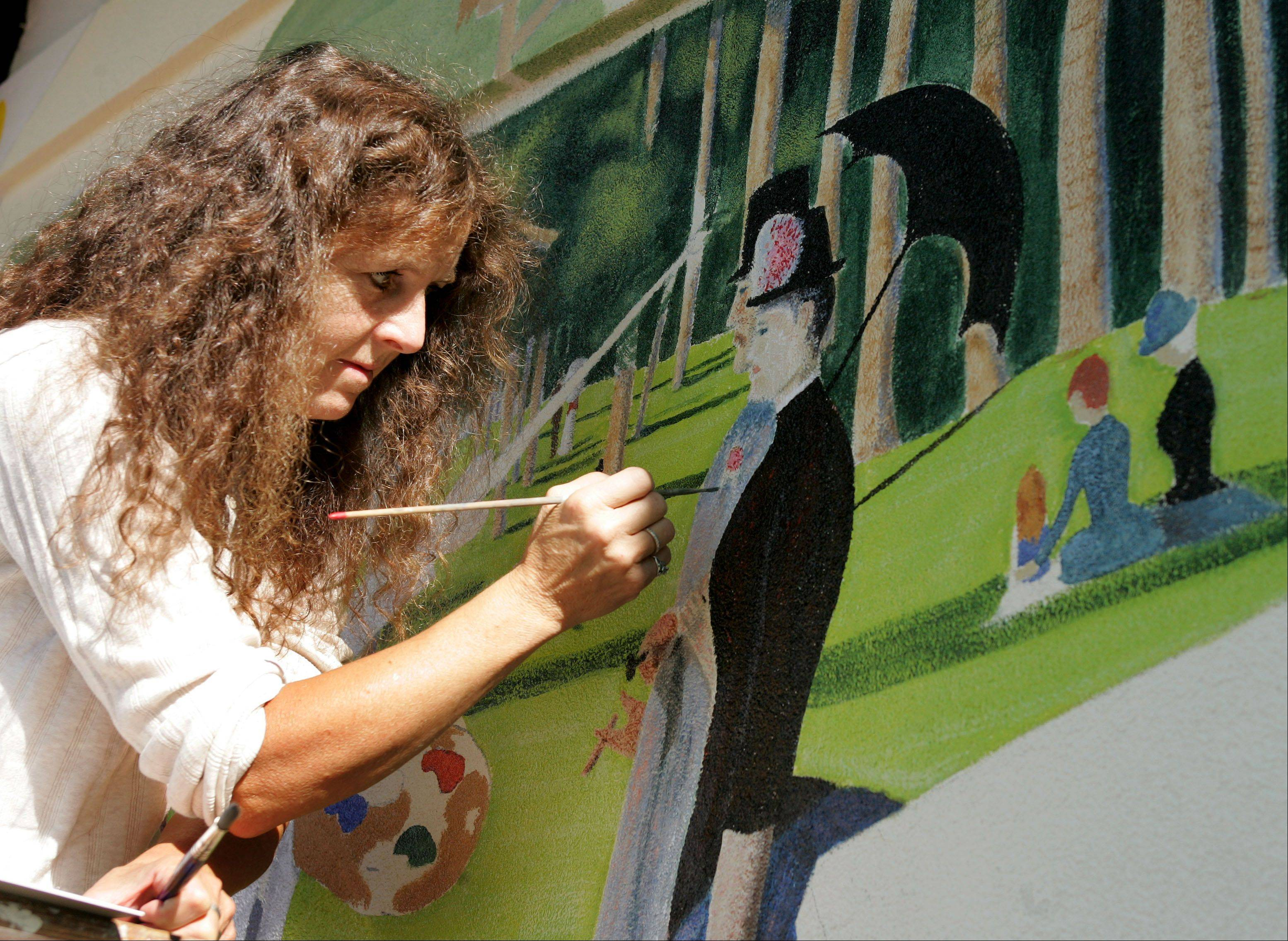 Marianne Lisson Kuhn has attended the Naperville Woman's Club Fine Art Fair for more than 20 years. She is known for her murals on Naperville's Century Walk.