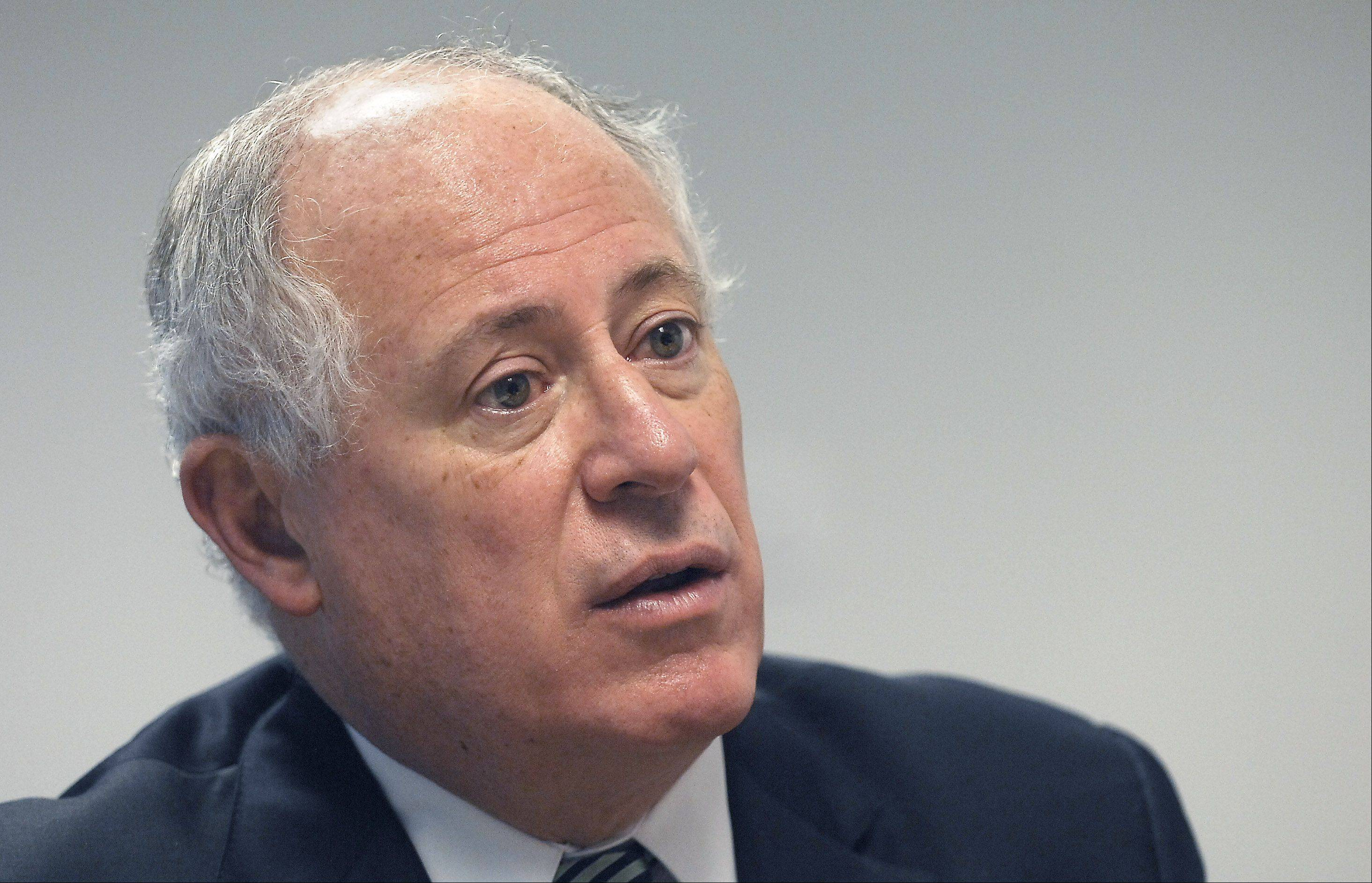 Gov. Pat Quinn attempted to suspend Illinois lawmakers' pay Wednesday, following through on his warning of consequences if they failed to end the state's nearly $100 billion pension crisis, the worst of any state nationwide.