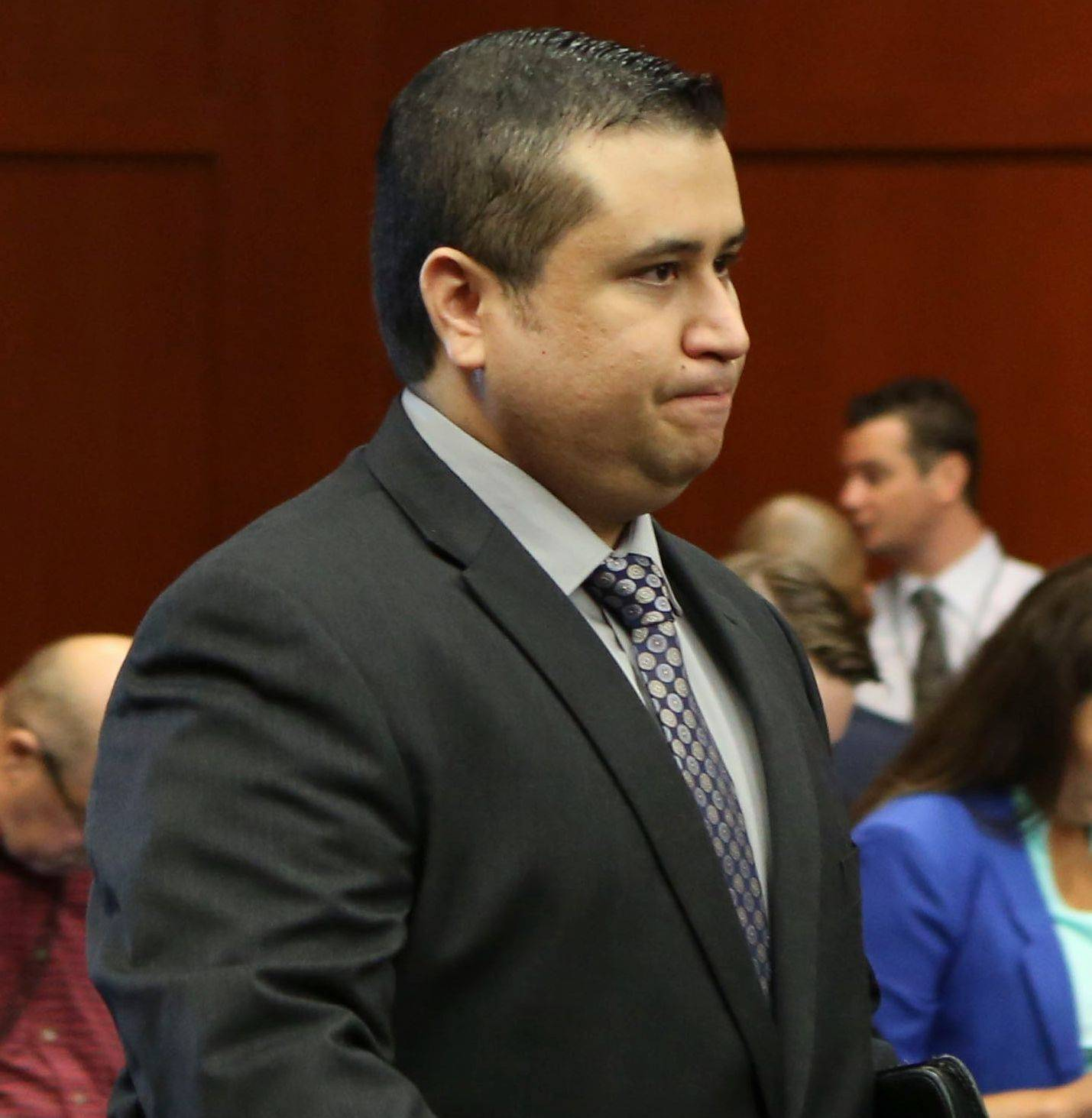 George Zimmerman enters the courtroom for his trial in Seminole circuit court in Sanford, Fla. Wednesday. He has been charged with second-degree murder in the 2012 shooting death of Trayvon Martin.