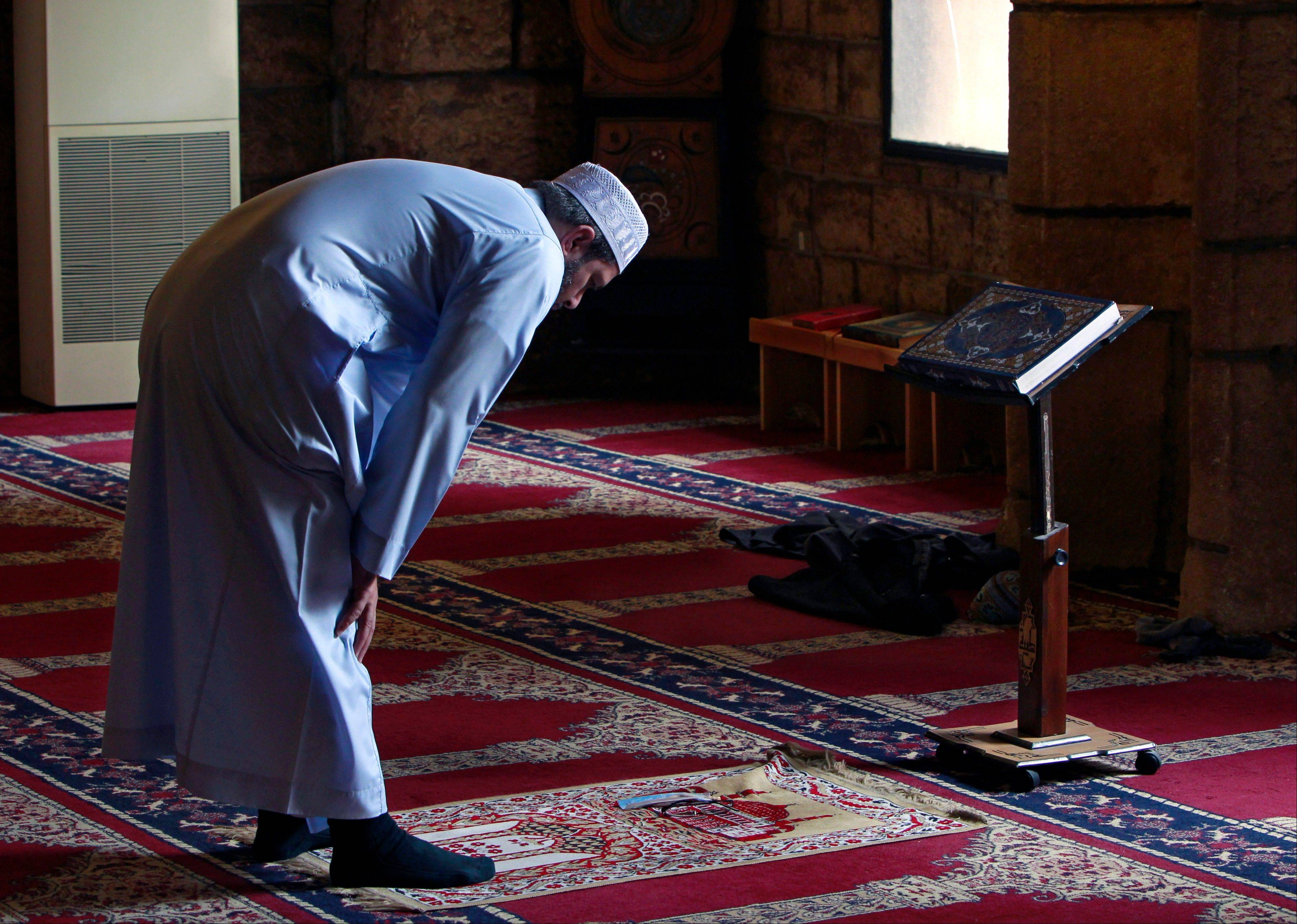 A Lebanese man prays at a mosque in Beirut, Lebanon, Wednesday, July 10, 2013. Many devout Muslims in the Middle East have started observing the dawn-to-dusk fast for the month of Ramadan even as the region is rocked by Egypt's turmoil and the relentless civil war in Syria. For most Sunnis and Shiites, Ramadan started on Wednesday while others are expected to begin observing the holy month on Thursday based on various sightings of the new moon.