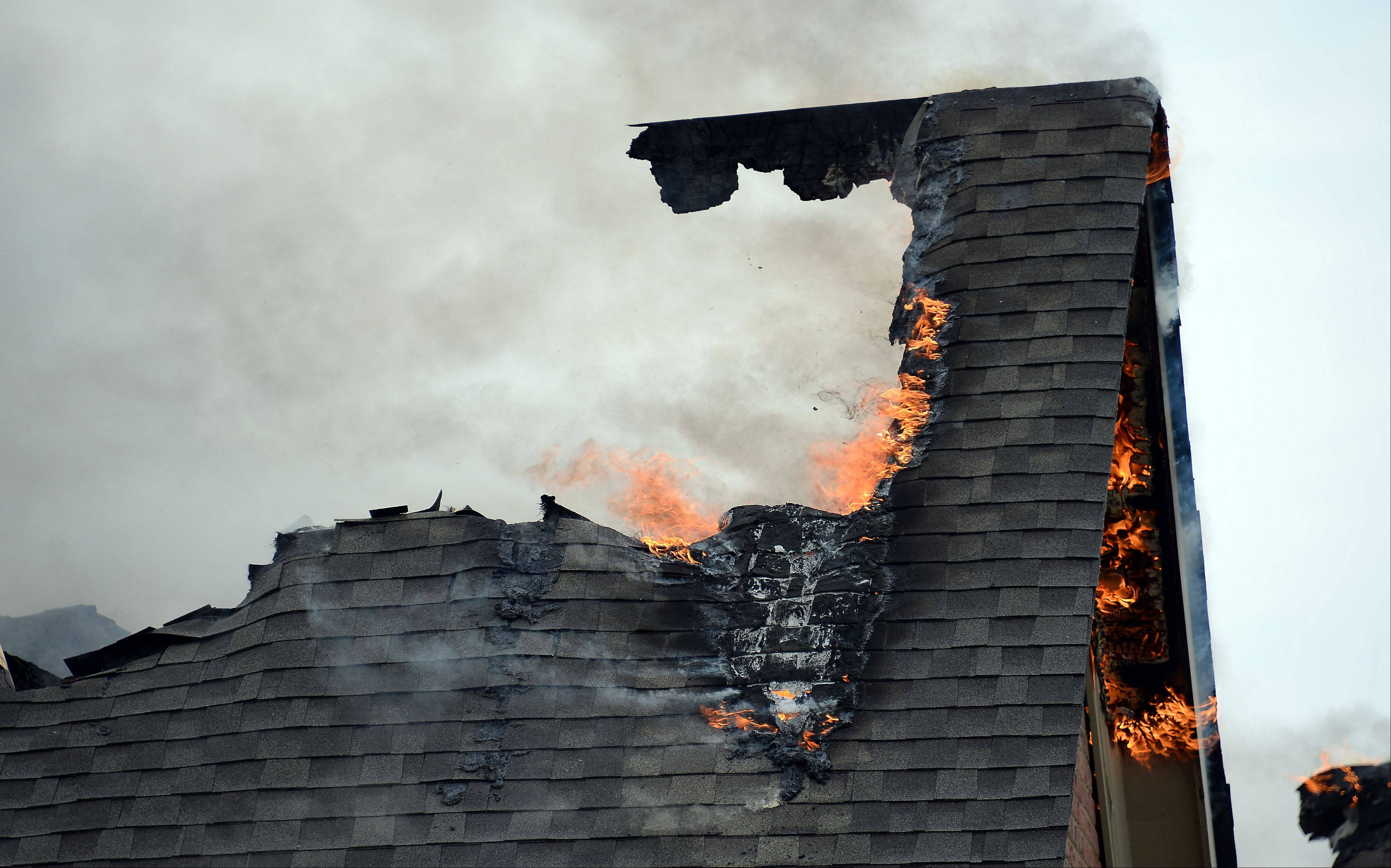 A fire does considerable damage to a house in the Terra Vita Estates subdivision in South Barrington yesterday.