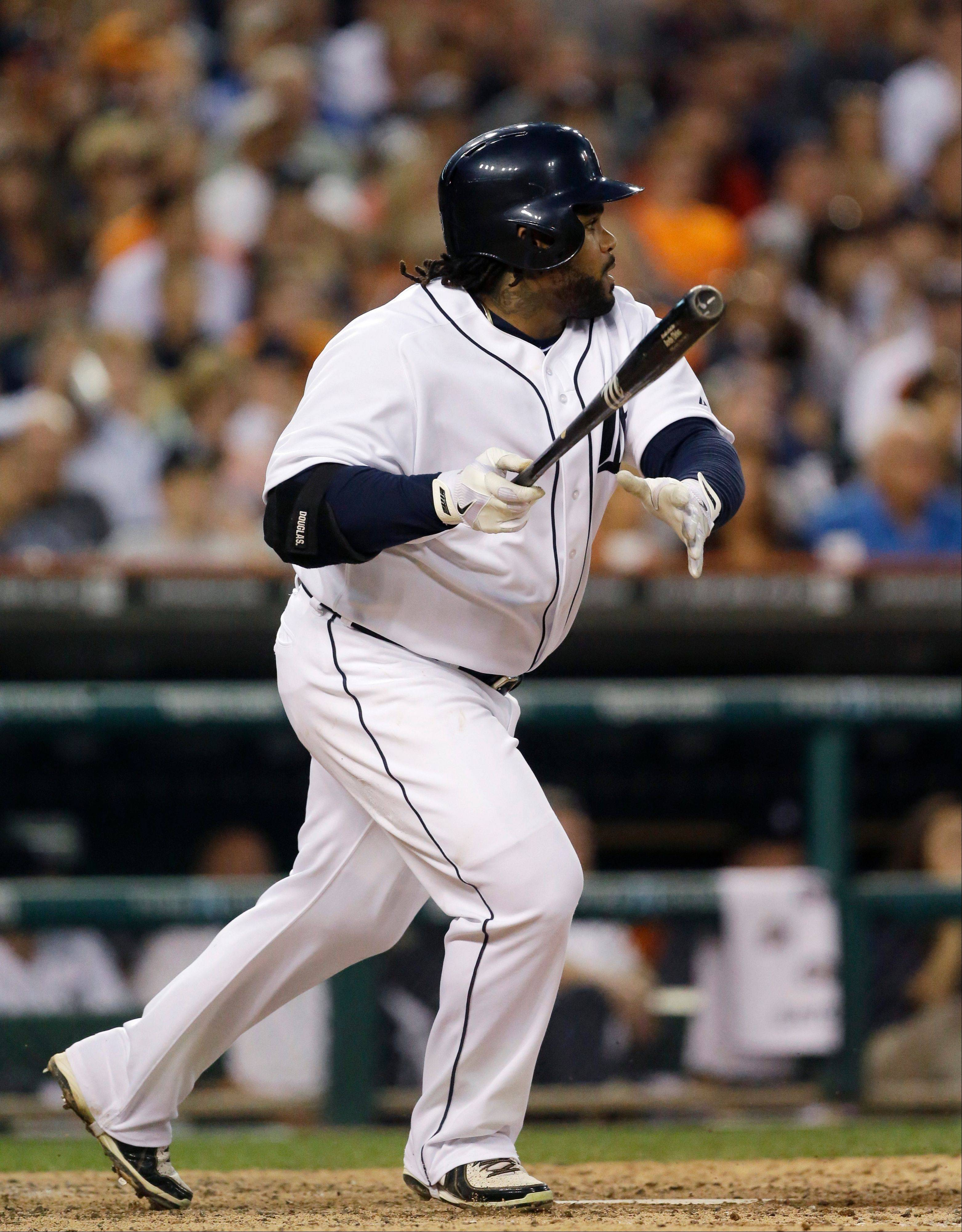 Prince Fielder singles to left field and drives in Torii Hunter from second during sixth inning of a baseball game against the Chicago White Sox in Detroit, Wednesday, July 10, 2013.