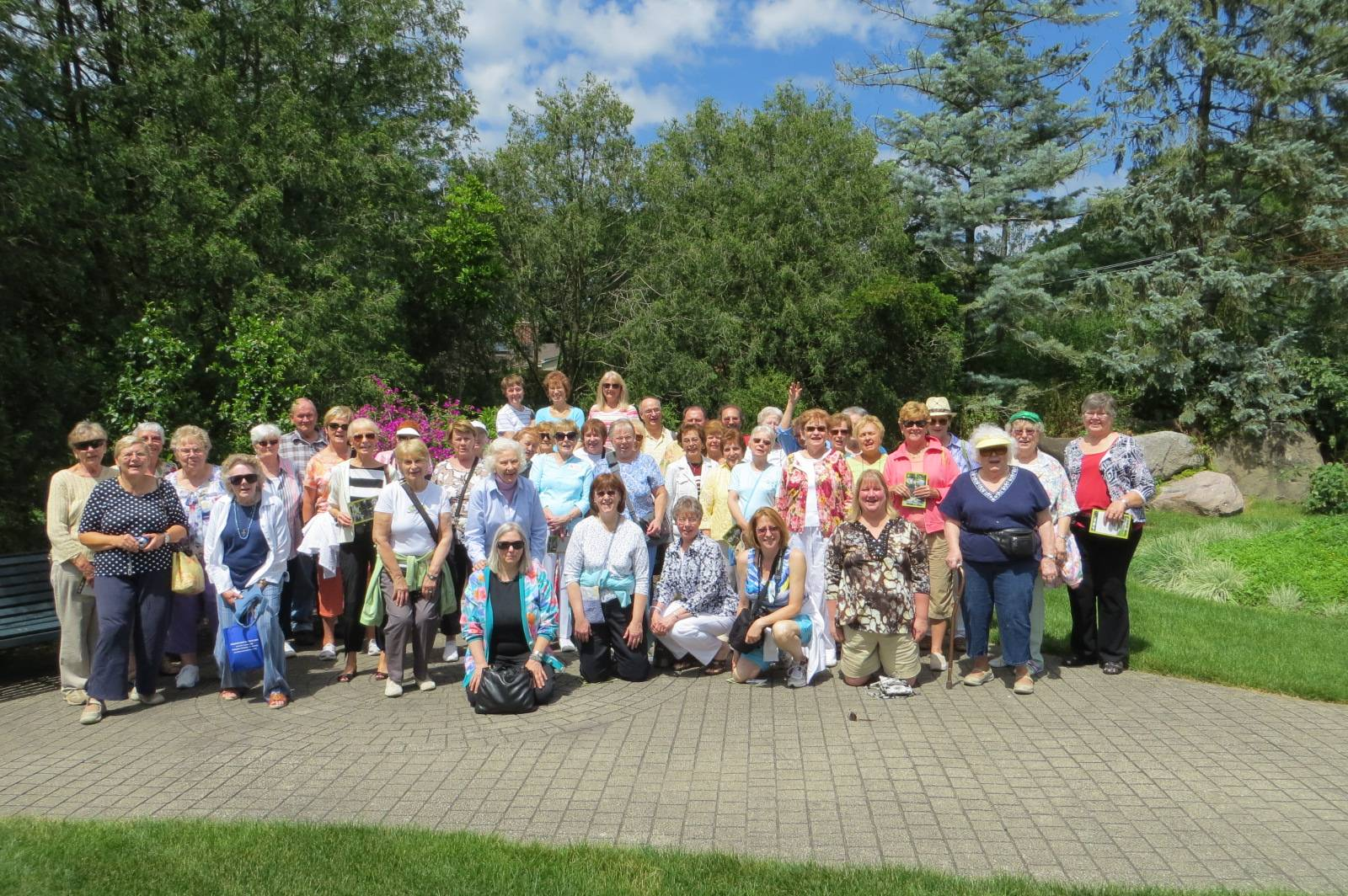 Members of the Des Plaines Garden Club admiring the LA Paloma Gardens in Rockford, IL