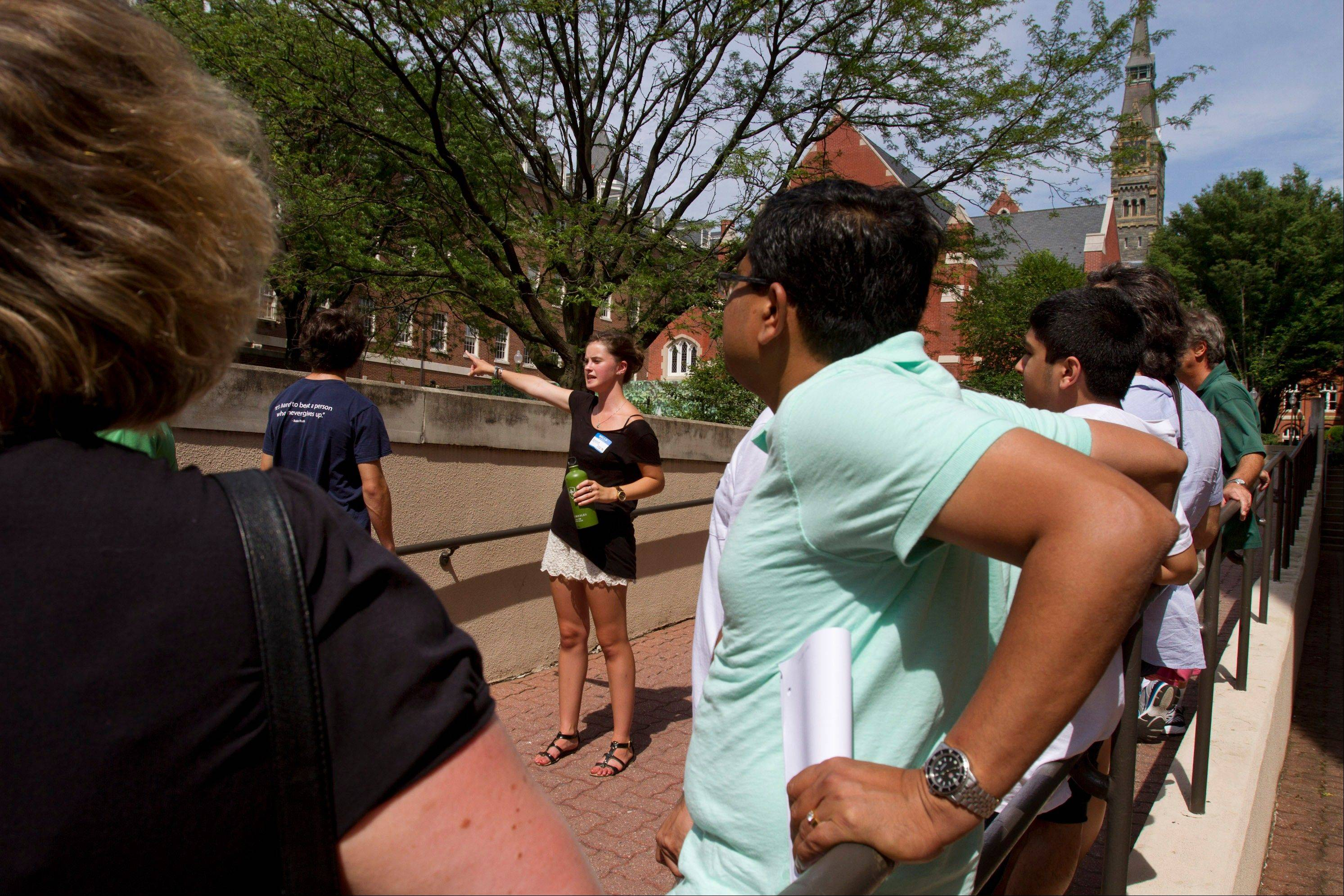 Prospective students and their parents tour Georgetown University's campus in Washington, Wednesday. The defeat of a student loan bill in the Senate on Wednesday clears the way for fresh negotiations to restore lower rates, but lawmakers are racing the clock before millions of students return to campus next month to find borrowing terms twice as high as when school let out.