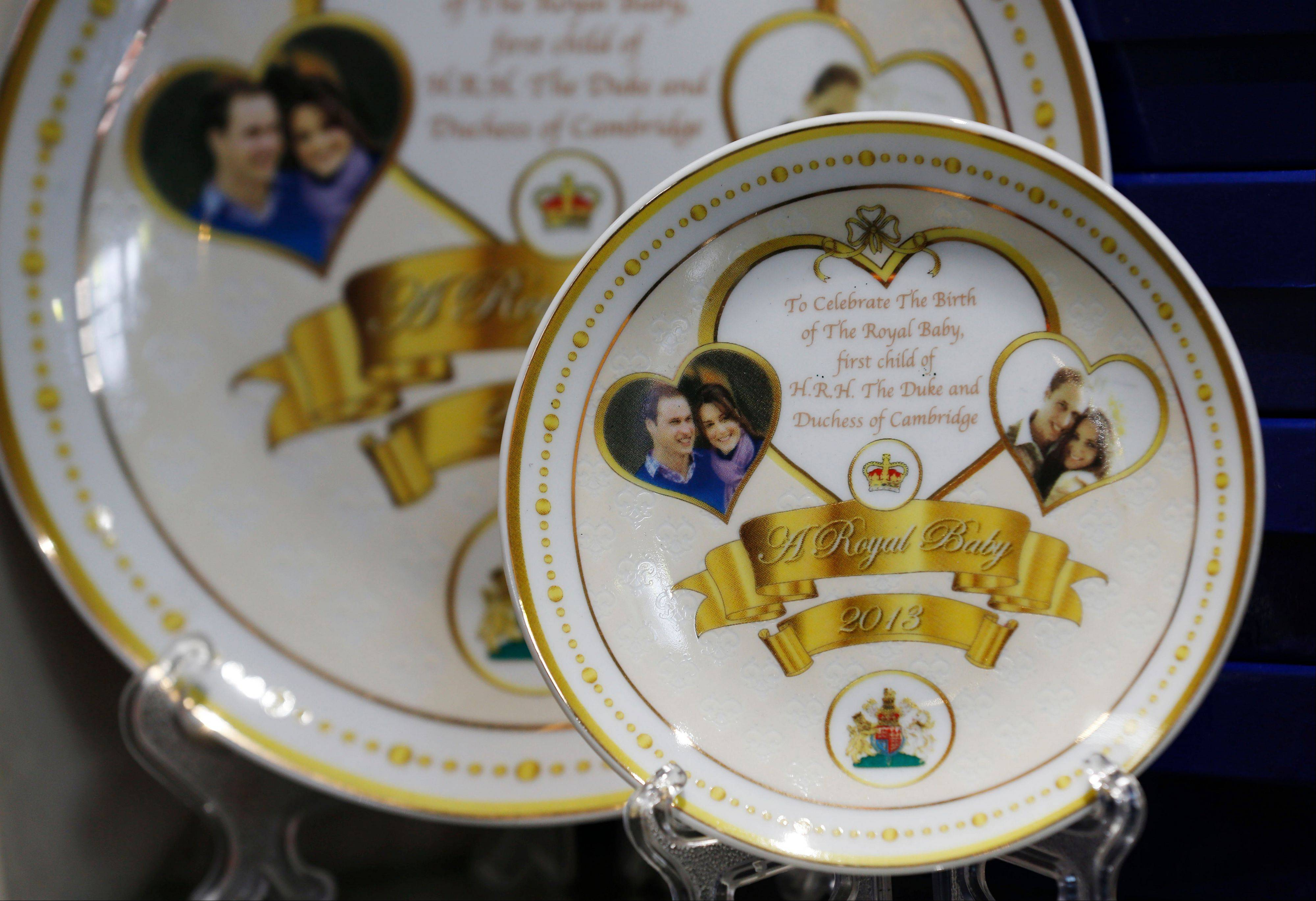 Souvenir plates to mark the forthcoming birth of Prince William and Kate, Duchess of Cambridge's baby are seen on display in a souvenir shop in central London, Wednesday, July 10, 2013.
