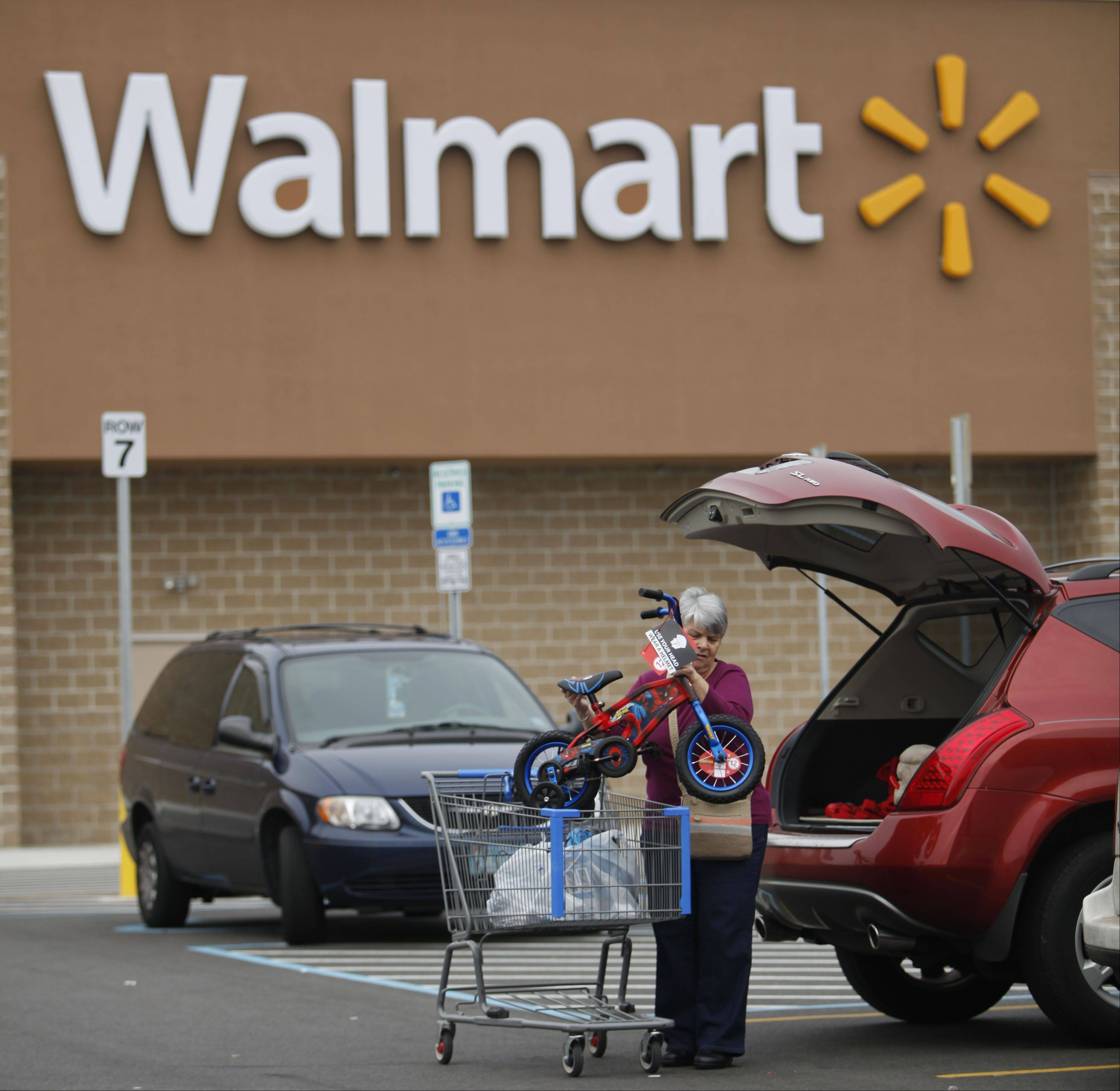 The D.C. Council issued a legislative rebuke to Wal-Mart on Wednesday, approving a bill that would require the retail giant and other big-box chain retailers operating in the nation�s capital to pay their employees a �living wage� of at least $12.50 an hour.