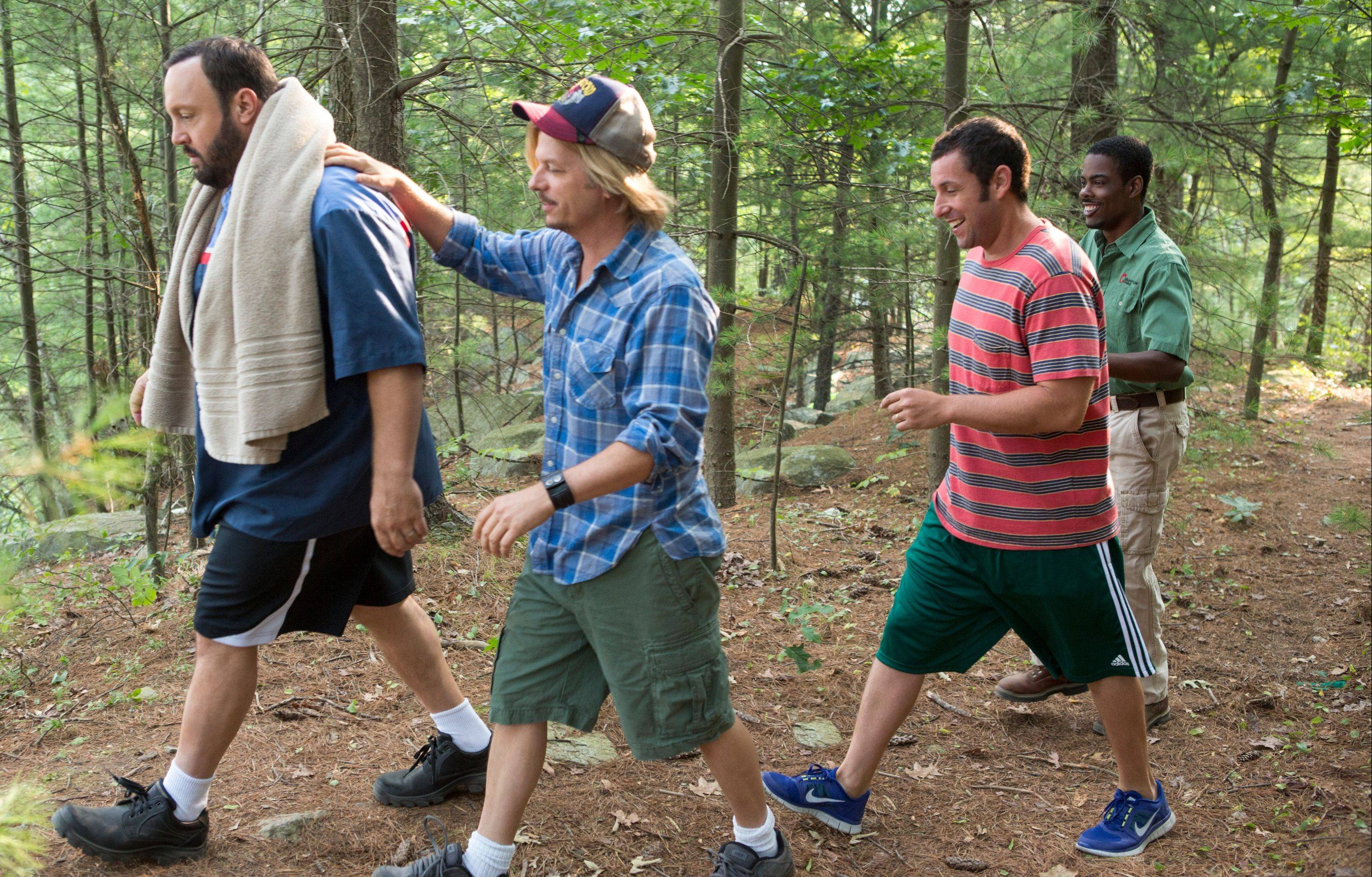 "Kevin James, left, David Spade, Adam Sandler and Chris Rock reunite in the childish ""Grown Ups 2."""