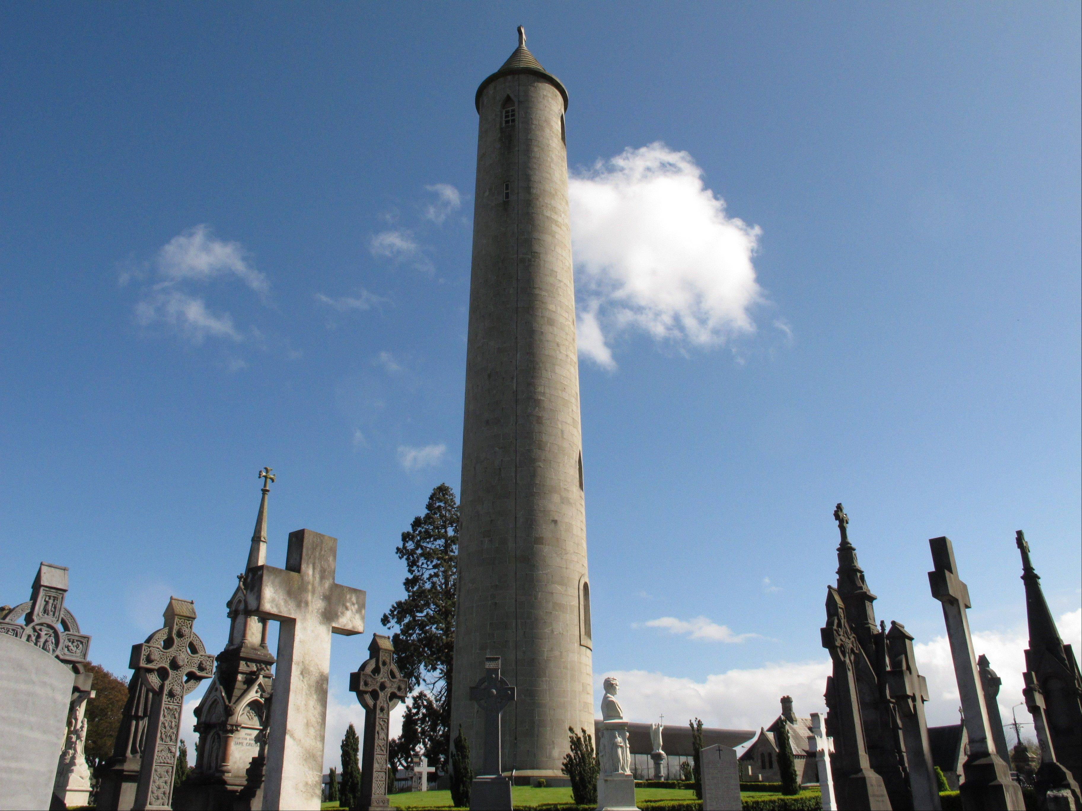 This May 13, 2013 photo shows the giant round tower above the grave of 19th Century Irish politician, Daniel O'Connell, who founded Glasnevin Cemetery in Dublin in 1832. The cemetery, steeped in Irish history, is hosting events related to The Gathering, a yearlong initiative to bring Irish emigrants and their descendants back to Ireland to celebrate their heritage. The cemetery's family events for clans (O'Neills, O'Donnells, O'Briens, etc.) include a walking tour, a museum visit and help in tracing kin. (AP Photo/Helen O'Neill)