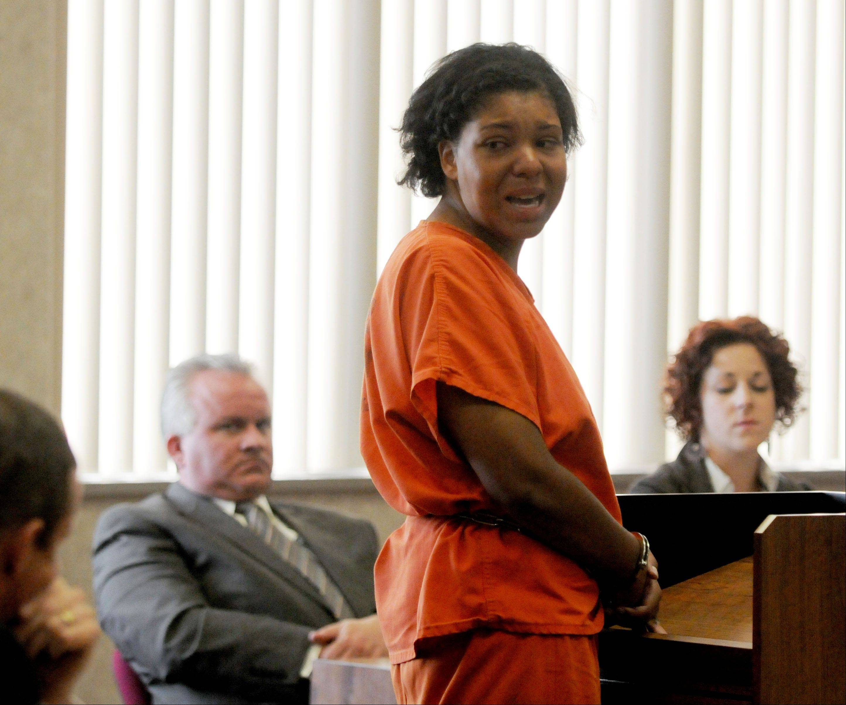 Tia Skinner looks to her family and addresses them during her resentencing hearing in 31st Circuit court in Port Huron, Mich. on Thursday, July 11, 2013. Skinner, who was convicted of plotting to have her father stabbed to death when she was just 17 years old was sentenced again to life in prison without parole.