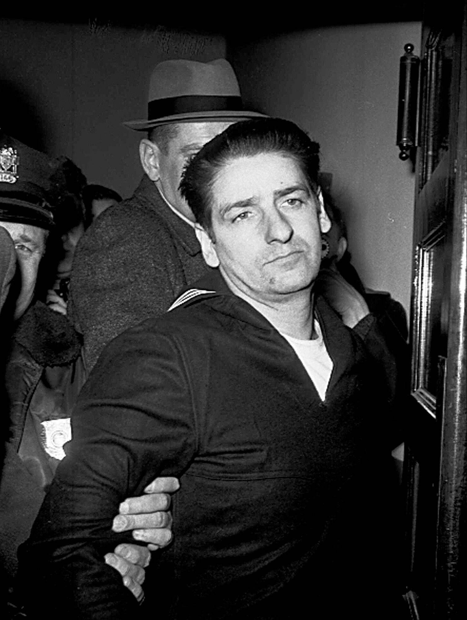 This Feb. 25, 1967, file photo shows self-confessed Boston Strangler Albert DeSalvo minutes after his capture in Boston. DeSalvo confessed to the string of 1960s killings but was never convicted. He died in prison in the 1970s.