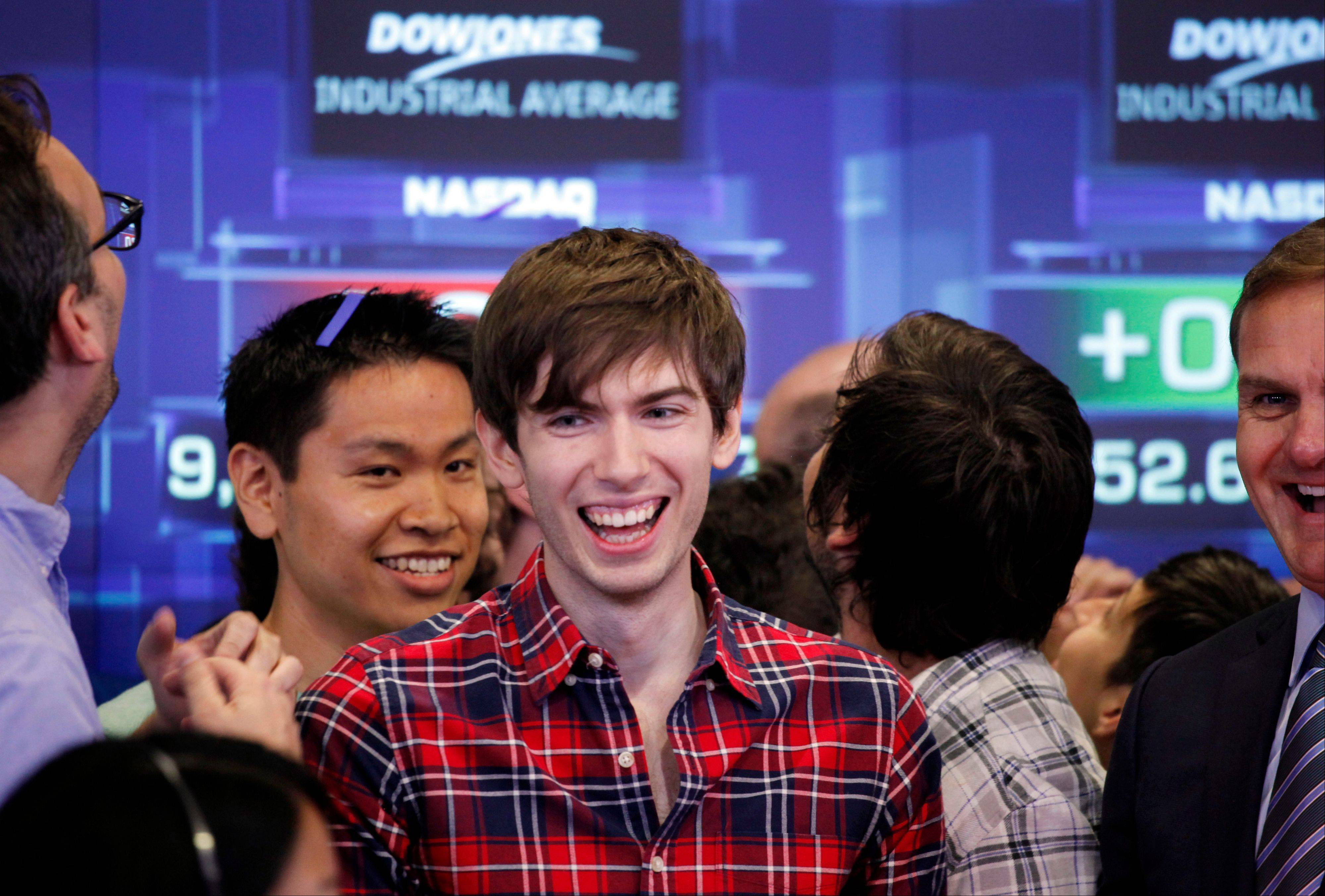 David Karp, center, founder and CEO of Tumblr, reacts during the opening bell at Nasdaq Thursday in New York. Yahoo acquired the online blogging forum for $1.1 billion in June. Tumblr will remain independently operated and Karp will stay CEO.