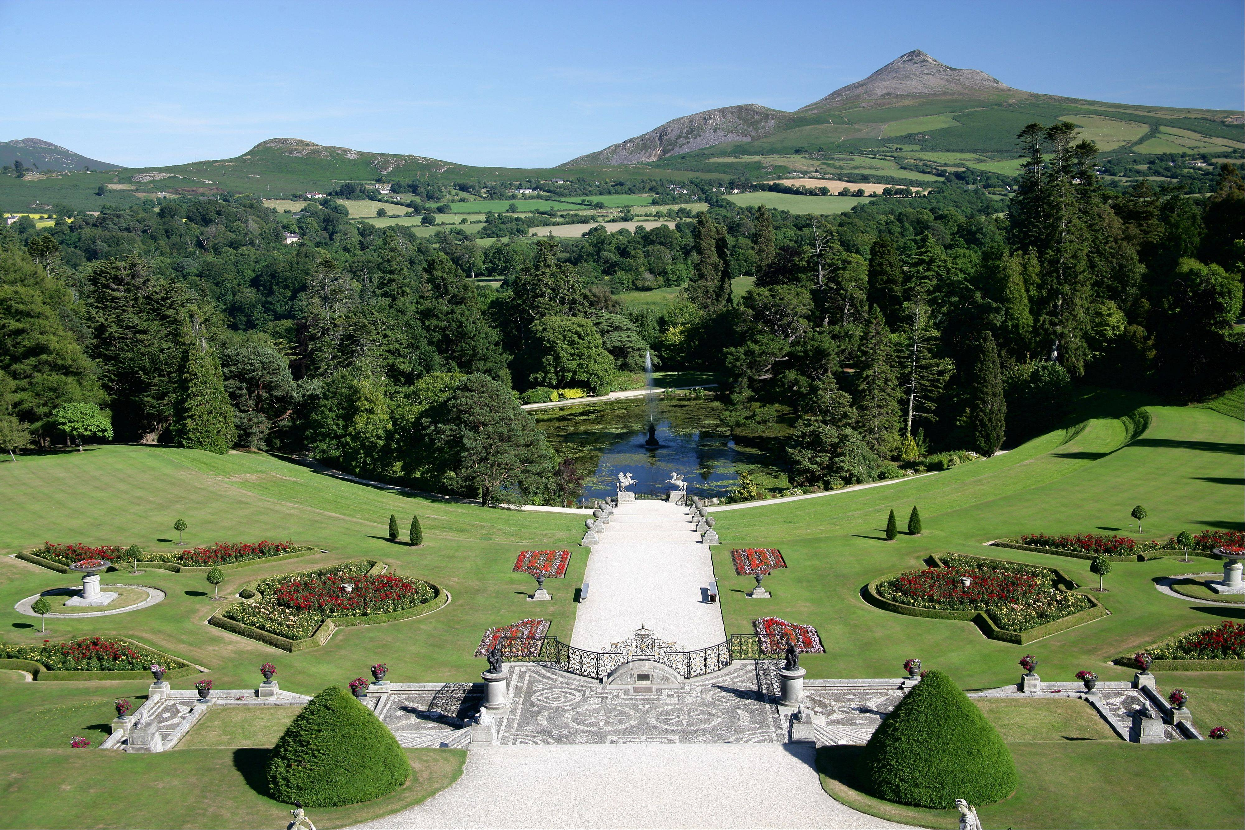 This undated photo from the Powerscourt Estate shows the gardens and grounds of the estate in Enniskerry, County Wicklow, Ireland, with the Wicklow Mountains in the background. The Powerscourt Estate and other great houses, castles and gardens in Ireland are hosting events connected to The Gathering, a yearlong nationwide event inviting Irish emigrants and their descendants home to celebrate their heritage. Powerscourt recently hosted a talk by a genealogist to help visitors track their �Wicklow roots.� (AP Photo/Powerscourt Estate)