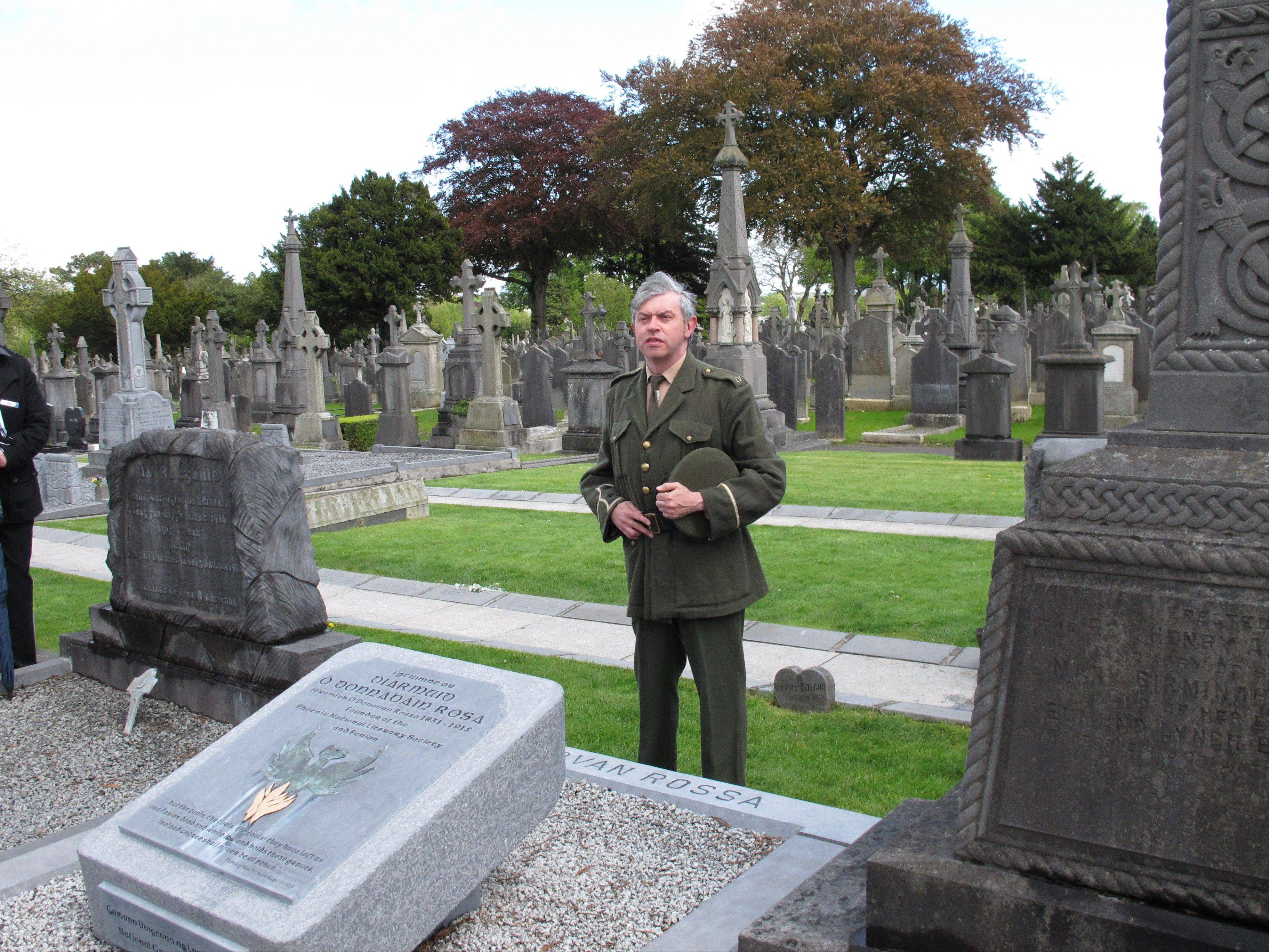 This May 13, 2013 photo shows an actor re-enacting Padraig Pearse's famous oration at the grave of Fenian Jeremiah O'Donovan Rossa, who died in 1915. The oration fueled Irish Republican sentiment which led to the Easter Rising a year later. The reenactment is part of a guided walking tour of the cemetery, which is hosting events related to The Gathering, a yearlong initiative to bring Irish emigrants and their descendants back to Ireland to celebrate their heritage. (AP Photo/Helen O'Neill)