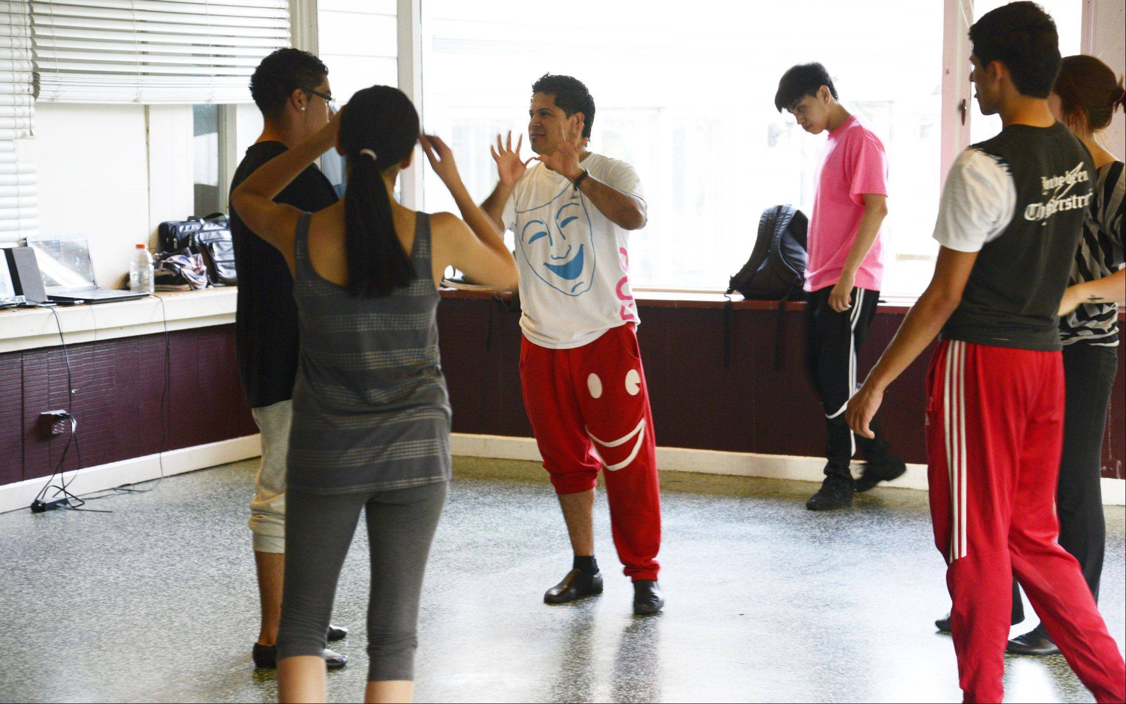 Ivan Moctezuma directs some of his 25 student dancers in his temporary studio in the Milk Pail banquet hall on Route 25 in East Dundee. Moctezuma and his brother, Angel, own and operate Ivangel Dance Studio.