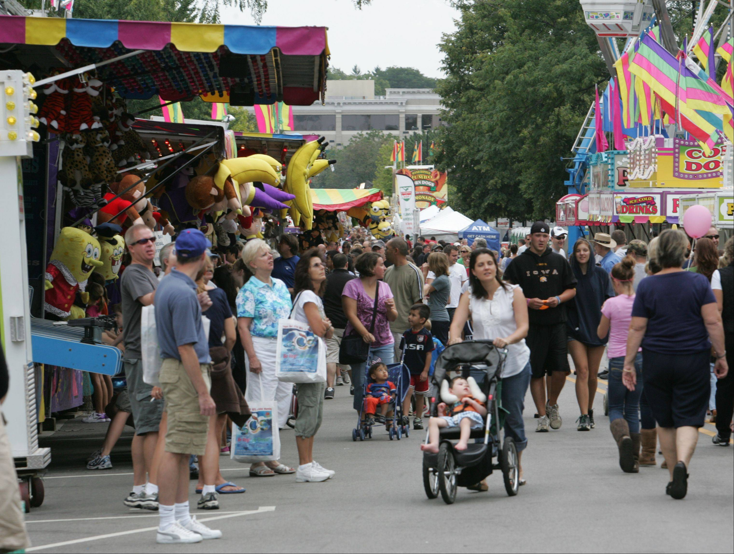 Thirsty visitors to this year's Last Fling festival in Naperville will have to buy beverage tickets worth $1 each before purchasing drinks, festival organizers told the city's liquor commission Thursday.