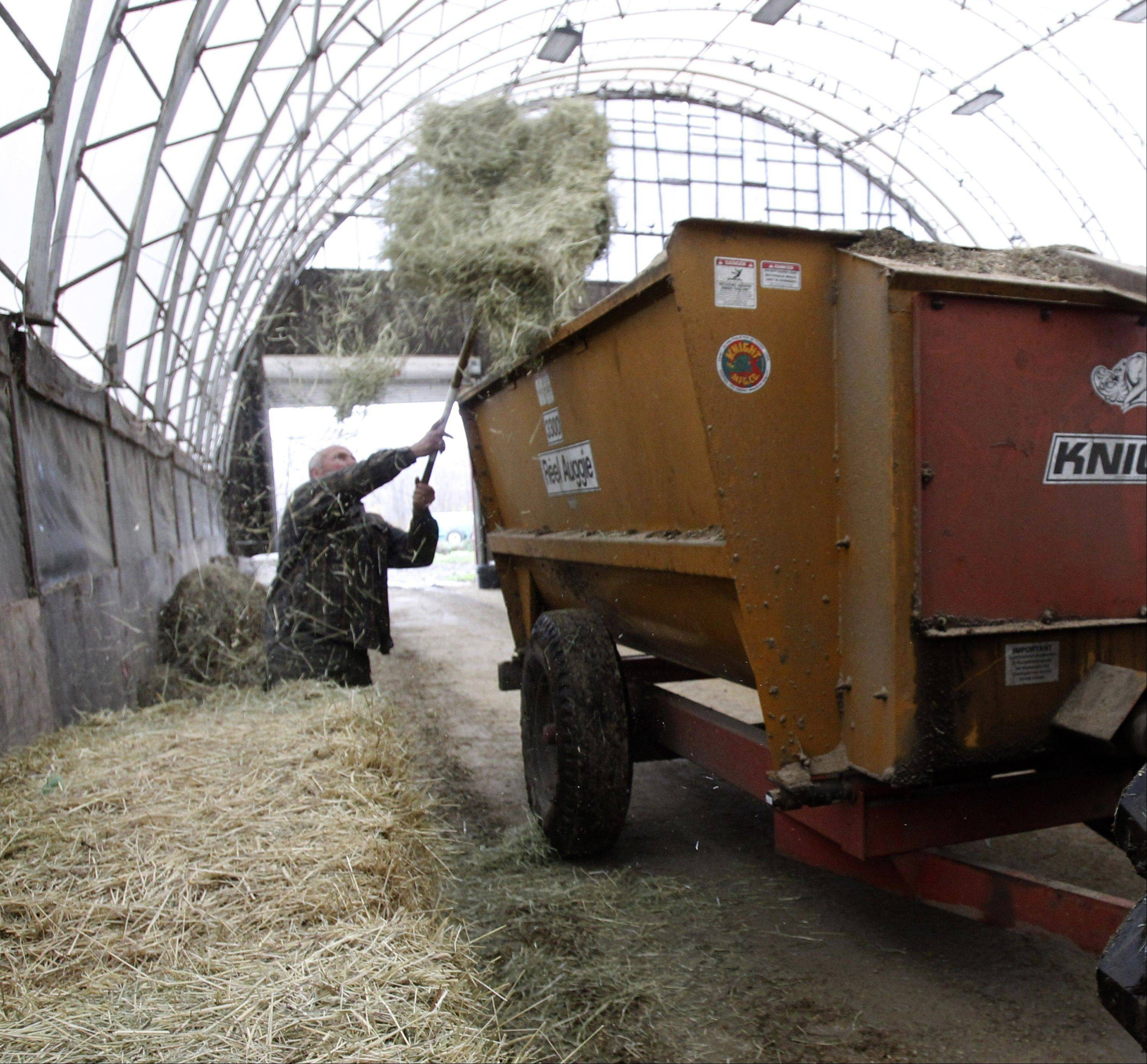 Farmer Myles Goodrich loading a feed wagon at his farm in Danville, Vt. House Repub