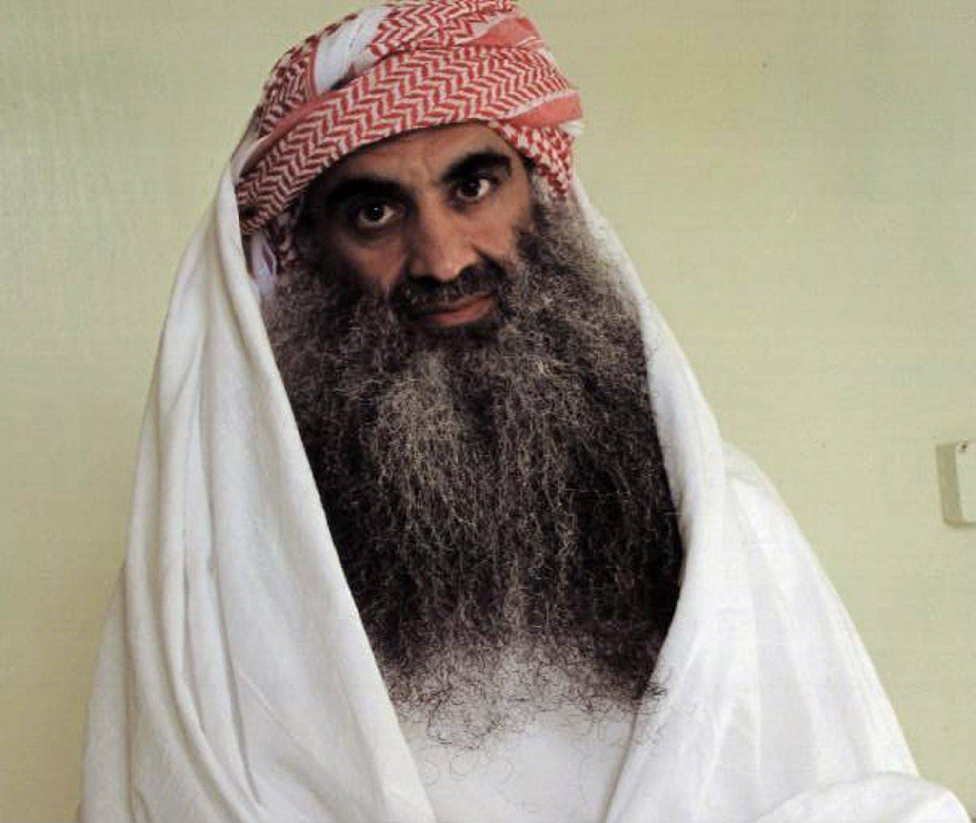 This file photo downloaded from the Arabic language web site www.muslm.net, believed to have been taken in July 2009, shows a man identified by the site as Khalid Sheikh Mohammed, the accused mastermind of the Sept. 11 attacks, in detention at Guantanamo Bay, Cuba.