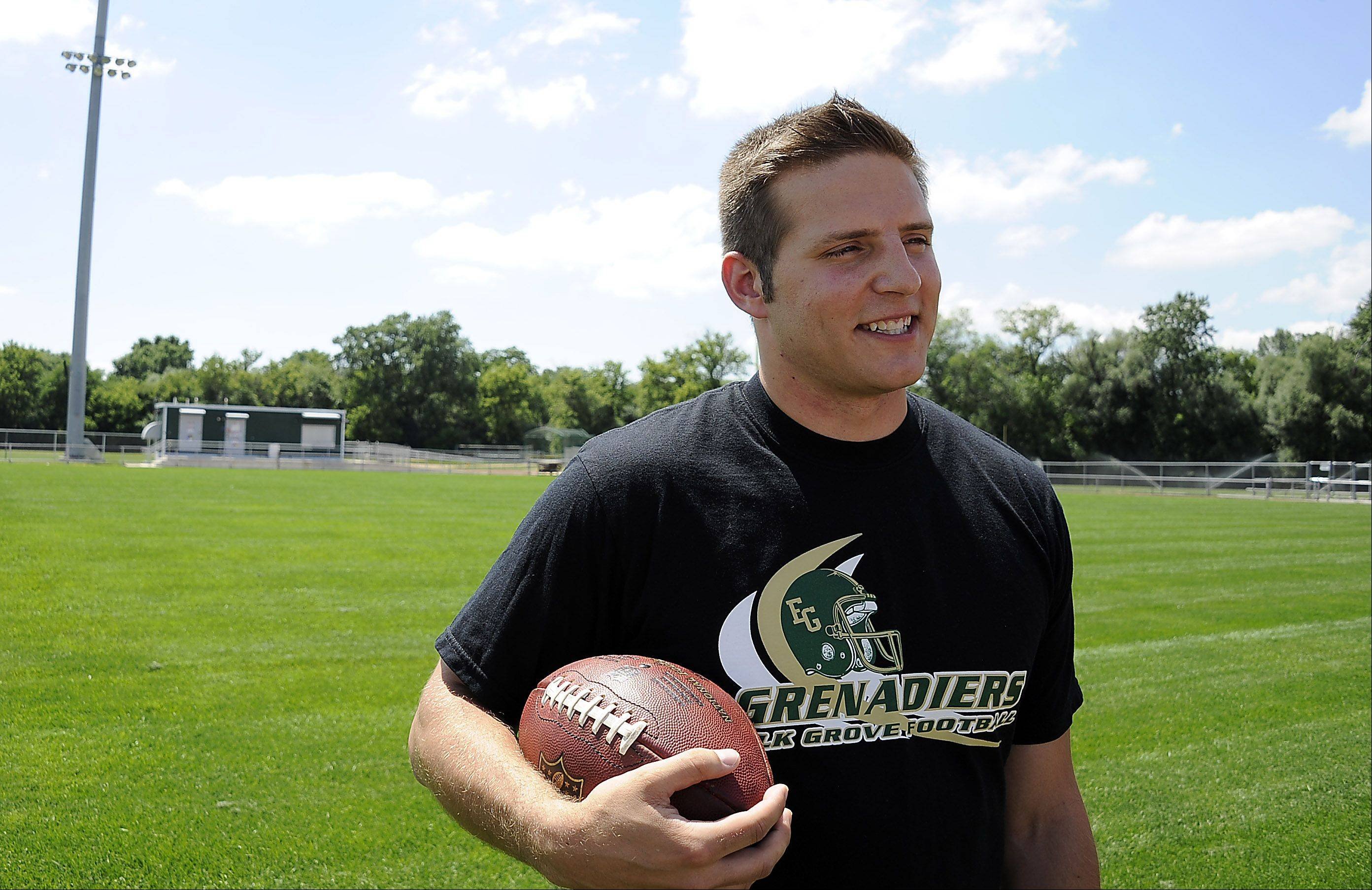 Standing on Elk Grove High School's football field, graduate Tom Kudyba, 28, a former quarterback for the school's football team, said he'd love to one day the head coach for the school. But for now he is headed to be the head coach for a professional football team in Brazil.