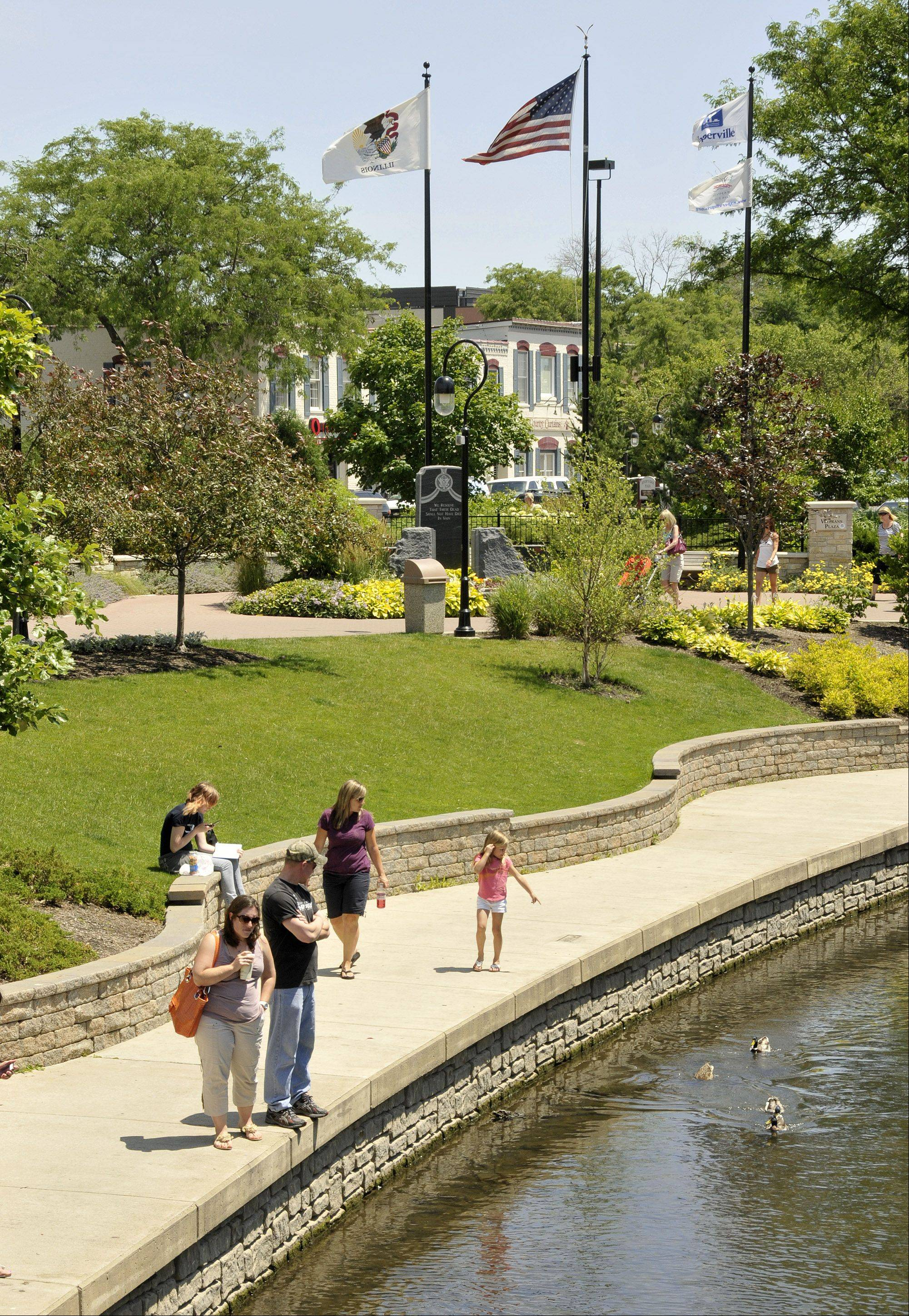 Naperville's Riverwalk Commission is going to ask the city and park district for permission to extend the iconic path by another block on its south end.