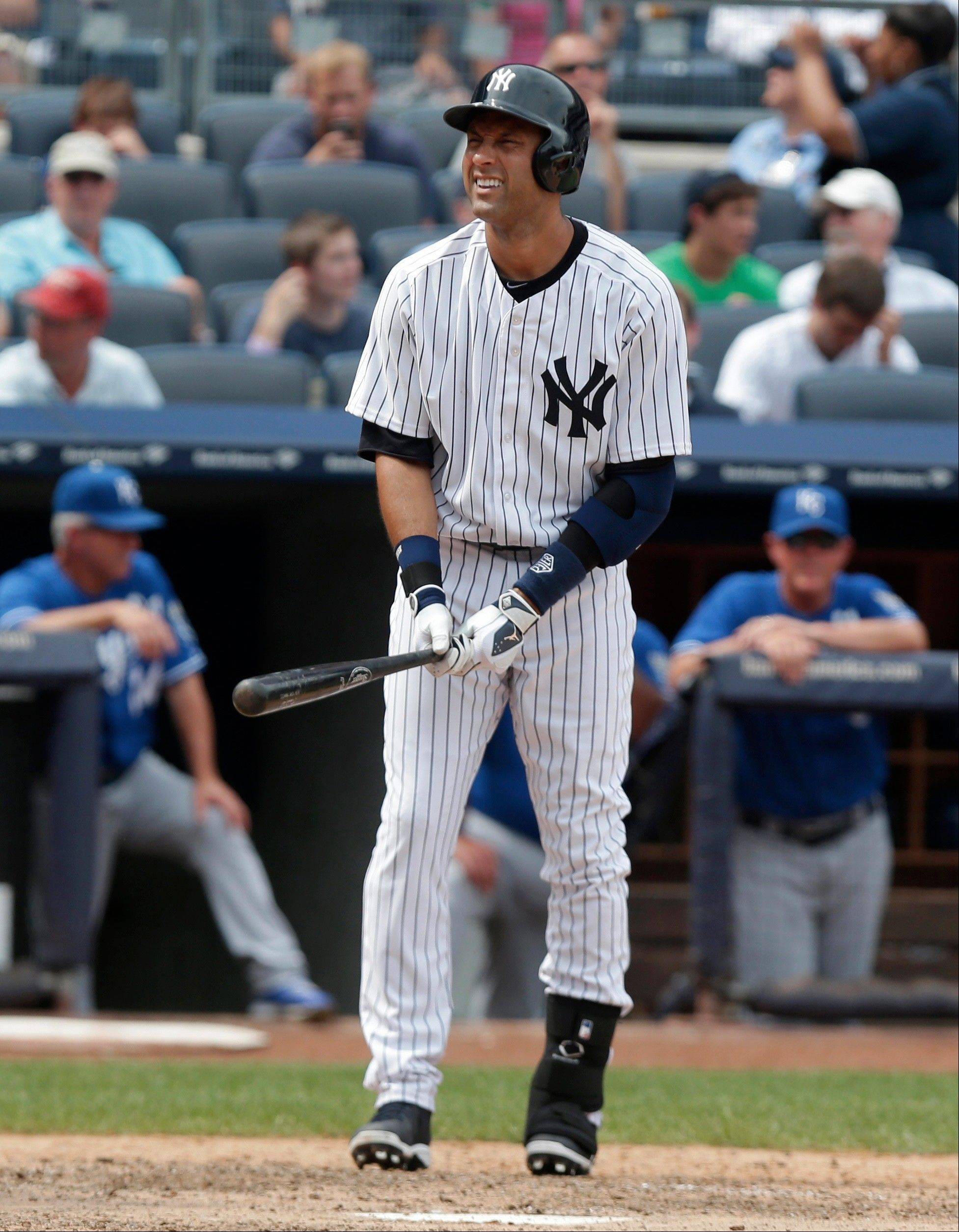 New York Yankees' Derek Jeter reacts during a sixth-inning at-bat in a baseball game against the Kansas City Royals at Yankee Stadium on Thursday, July 11, 2013, in New York. The Yankees beat the Royals 8-4. Jeter left the game early with a tight right quadriceps.