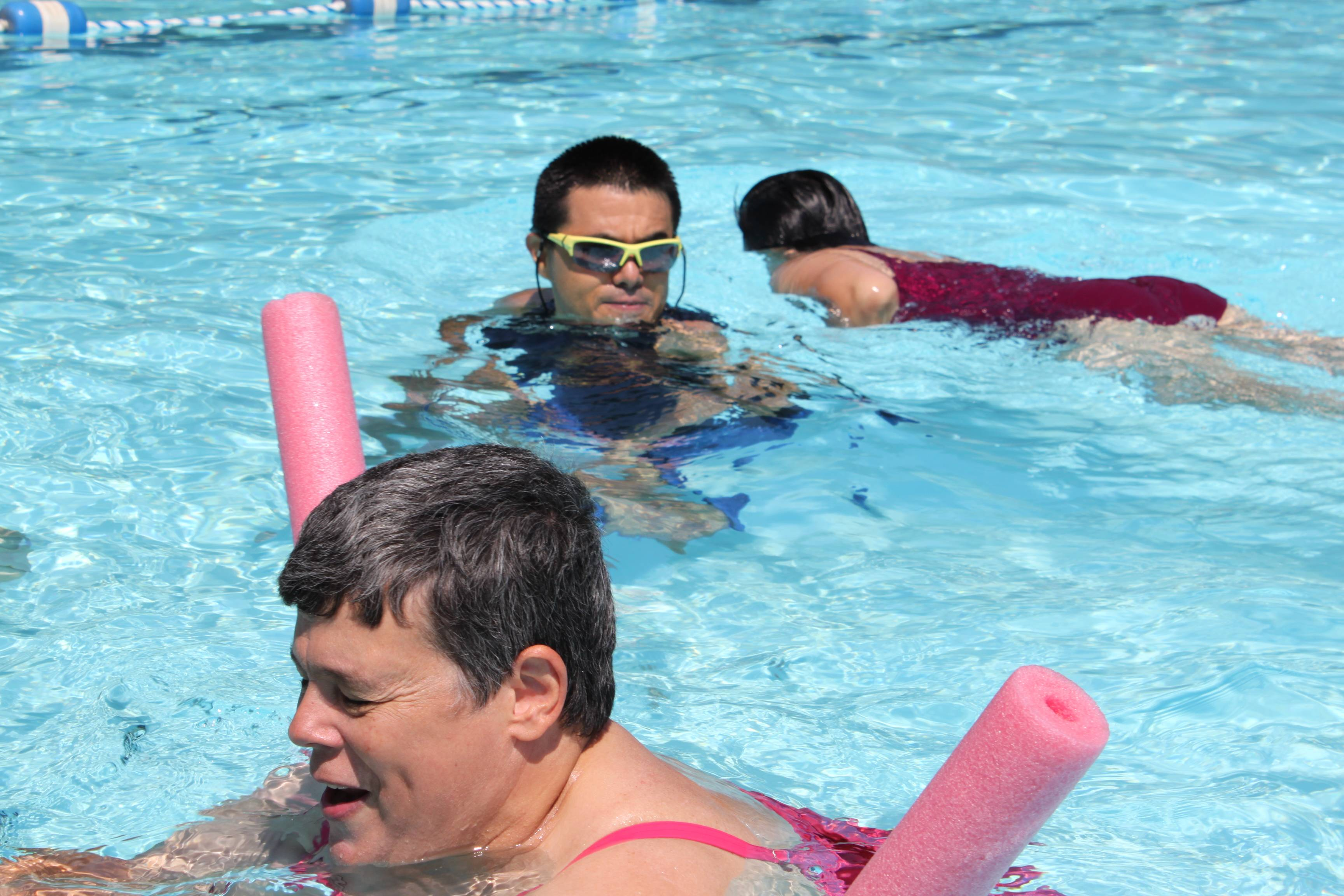 Connie Kaesmeyer (foreground), Angel Covarrubias (middle) and Helen Lee enjoy swimming in the Bensenville pool on a glorious July day.