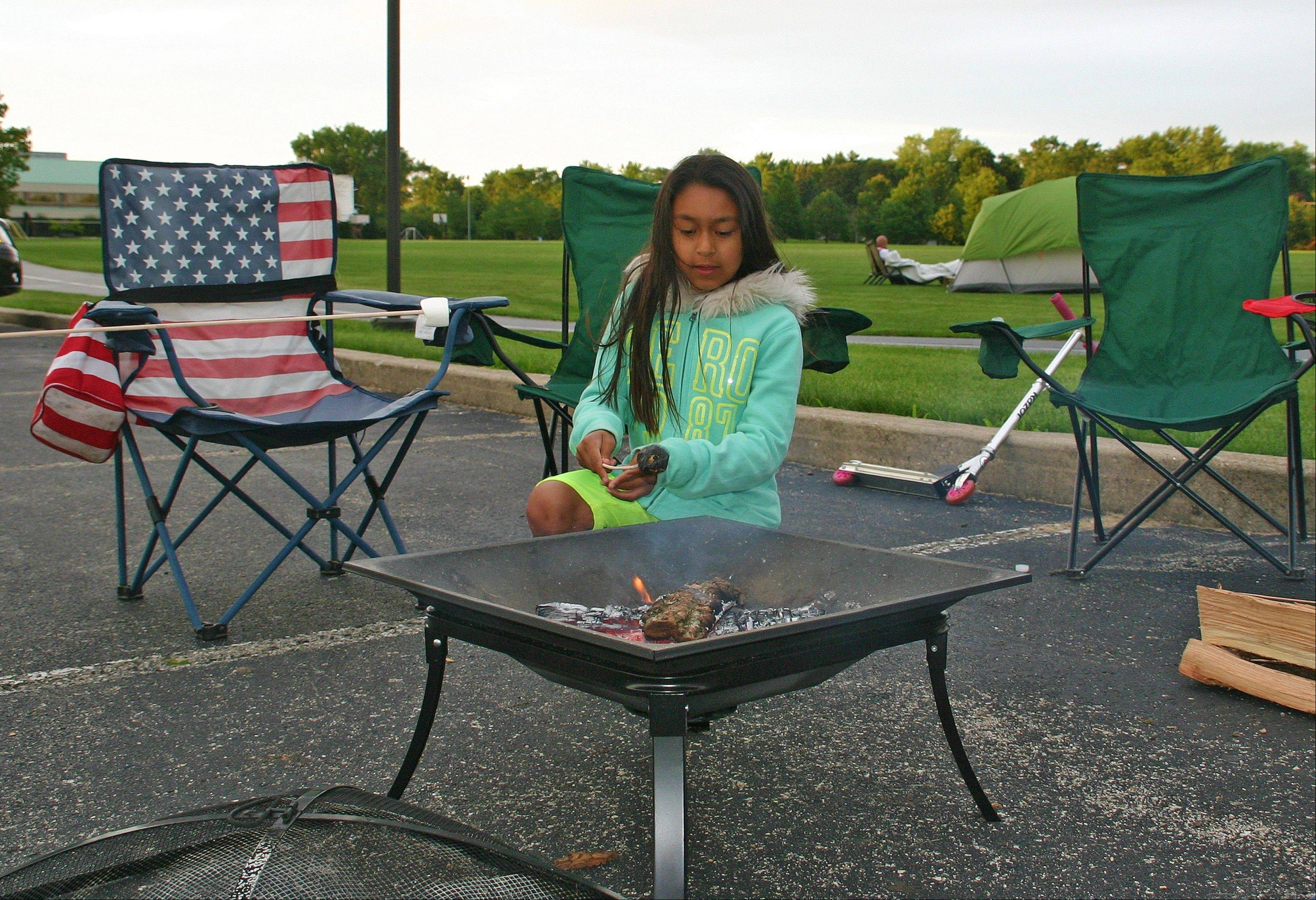 Samantha Servin roasts the perfect marshmallow at the second annual Family Campout at Prairie Lakes Park.