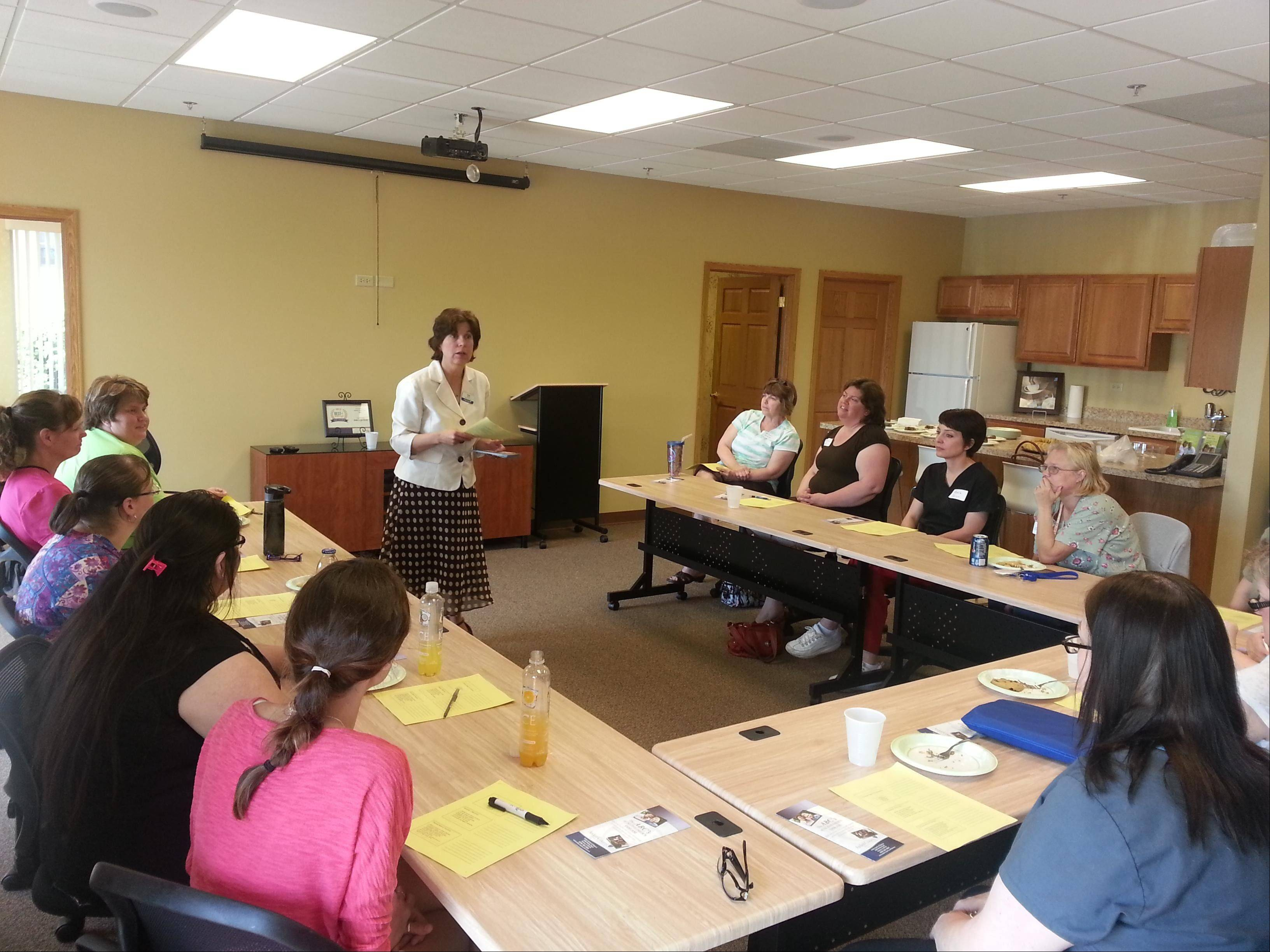 Pam Sebern of Arden Courts of Geneva conducts a training class for the CAN staff of Visiting Angels of South Elgin.