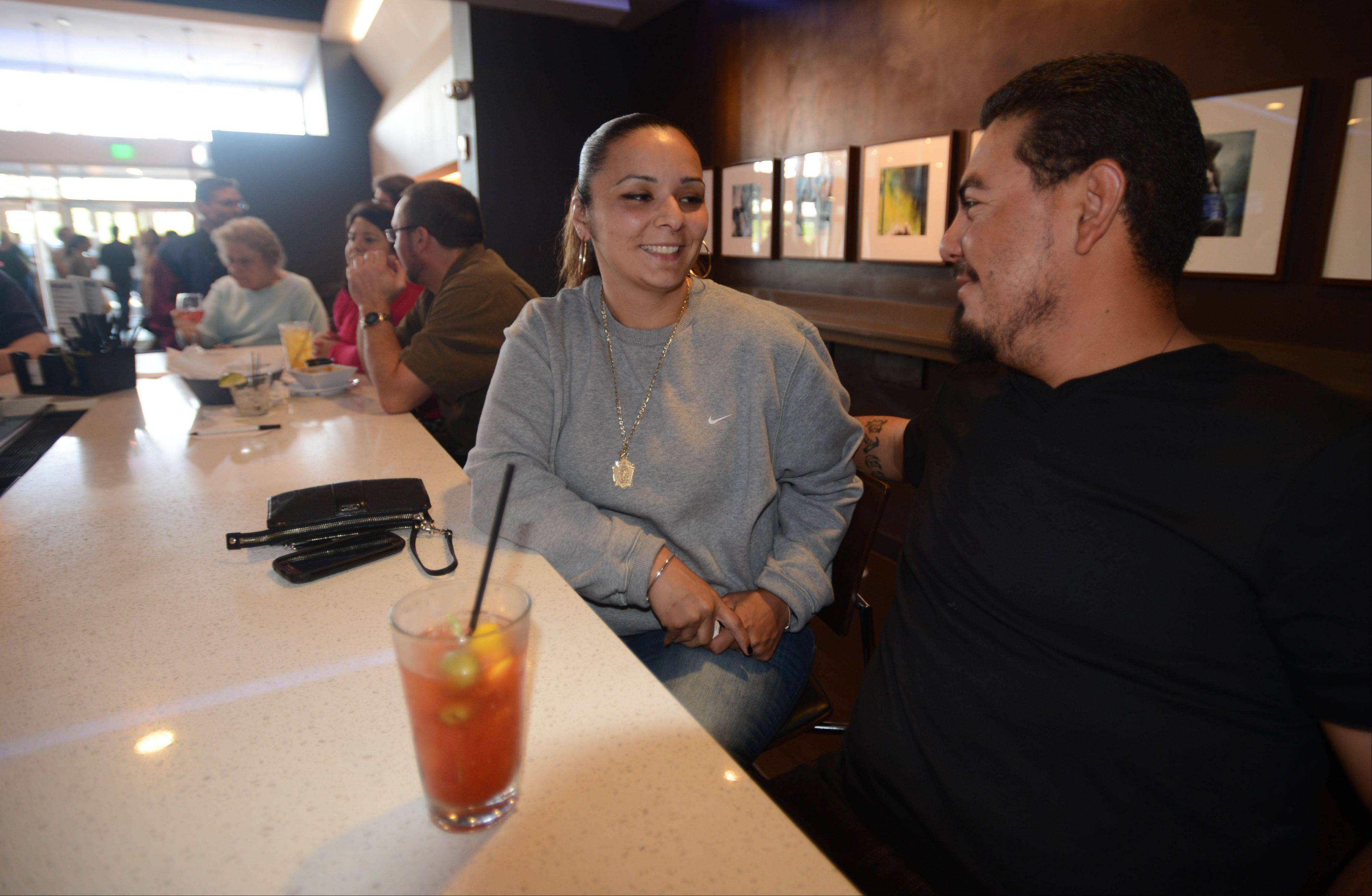 Jackie Plascencia and her husband Paco have a drink before catching a movie at Studio Movie Grill in Wheaton.