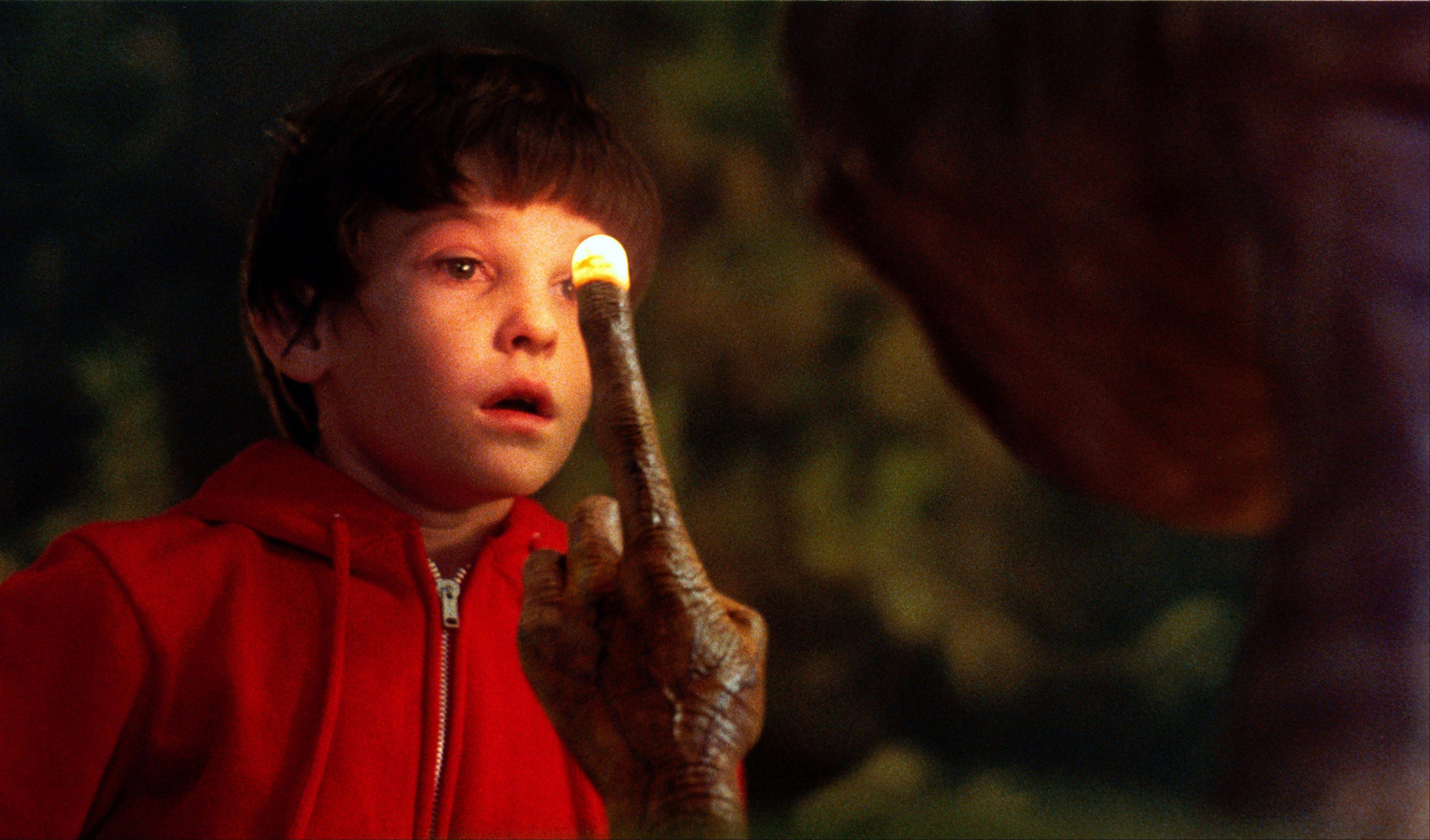 "Elliot (Henry Thomas) says a tearful goodbye to his alien friend at the end of Steven Spielberg's classic ""E.T.: The Extra-Terrestrial."""