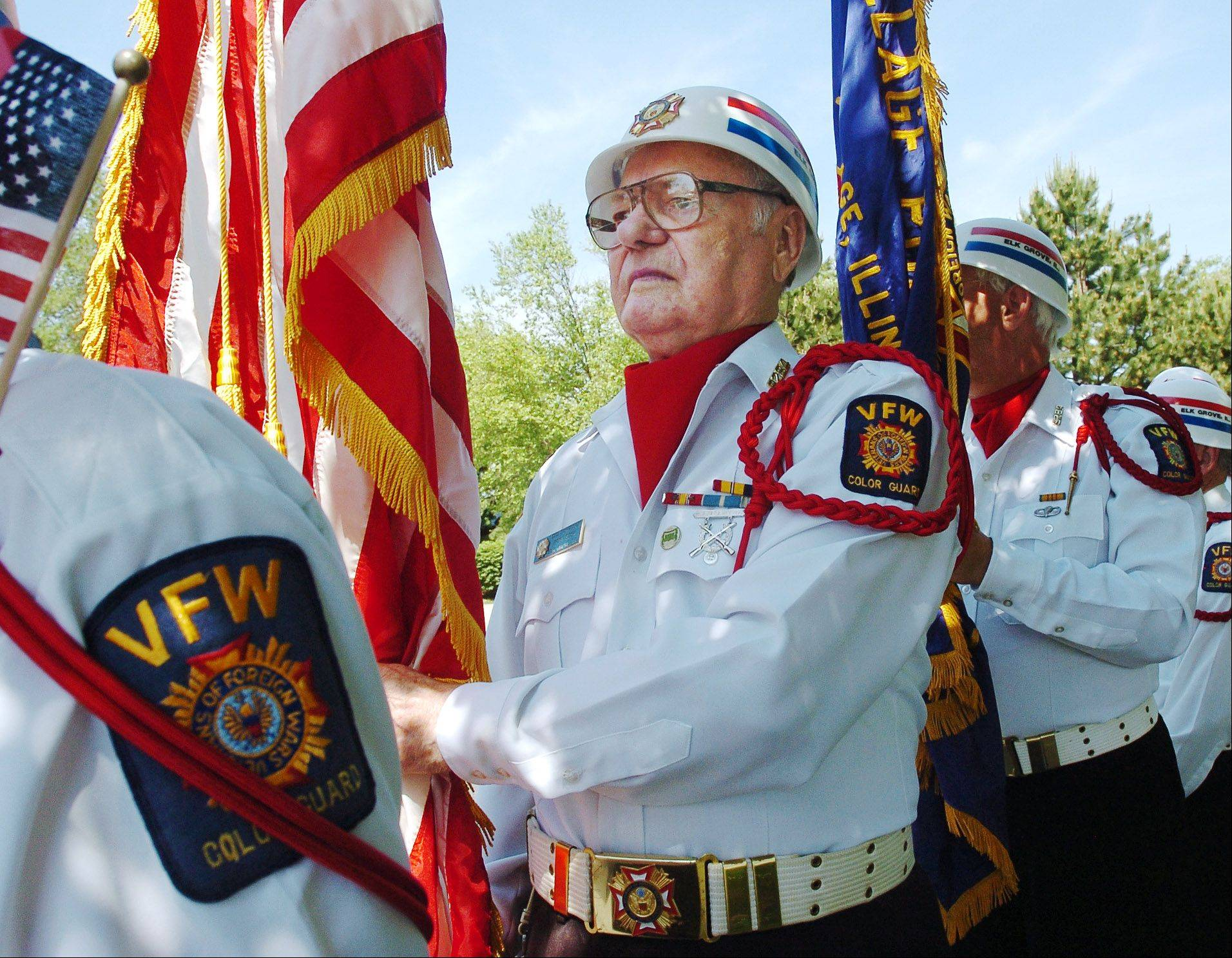 In 2006, Ted Torgesen, a Korean War veteran, carries the American flag at an Elk Grove Village Memorial Day ceremony.