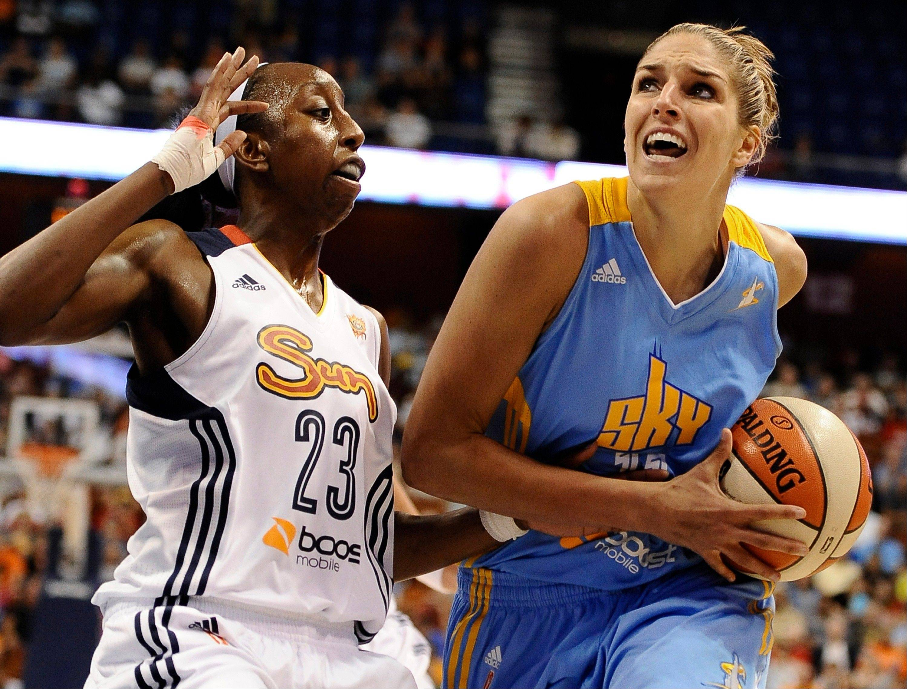 Chicago Sky's Elena Delle Donne, right, drives to the basket while being guarded by Connecticut Sun's Allison Hightower during the first half of a WNBA basketball game in Uncasville, Conn., Friday, July 12, 2013. (AP Photo/Jessica Hill)