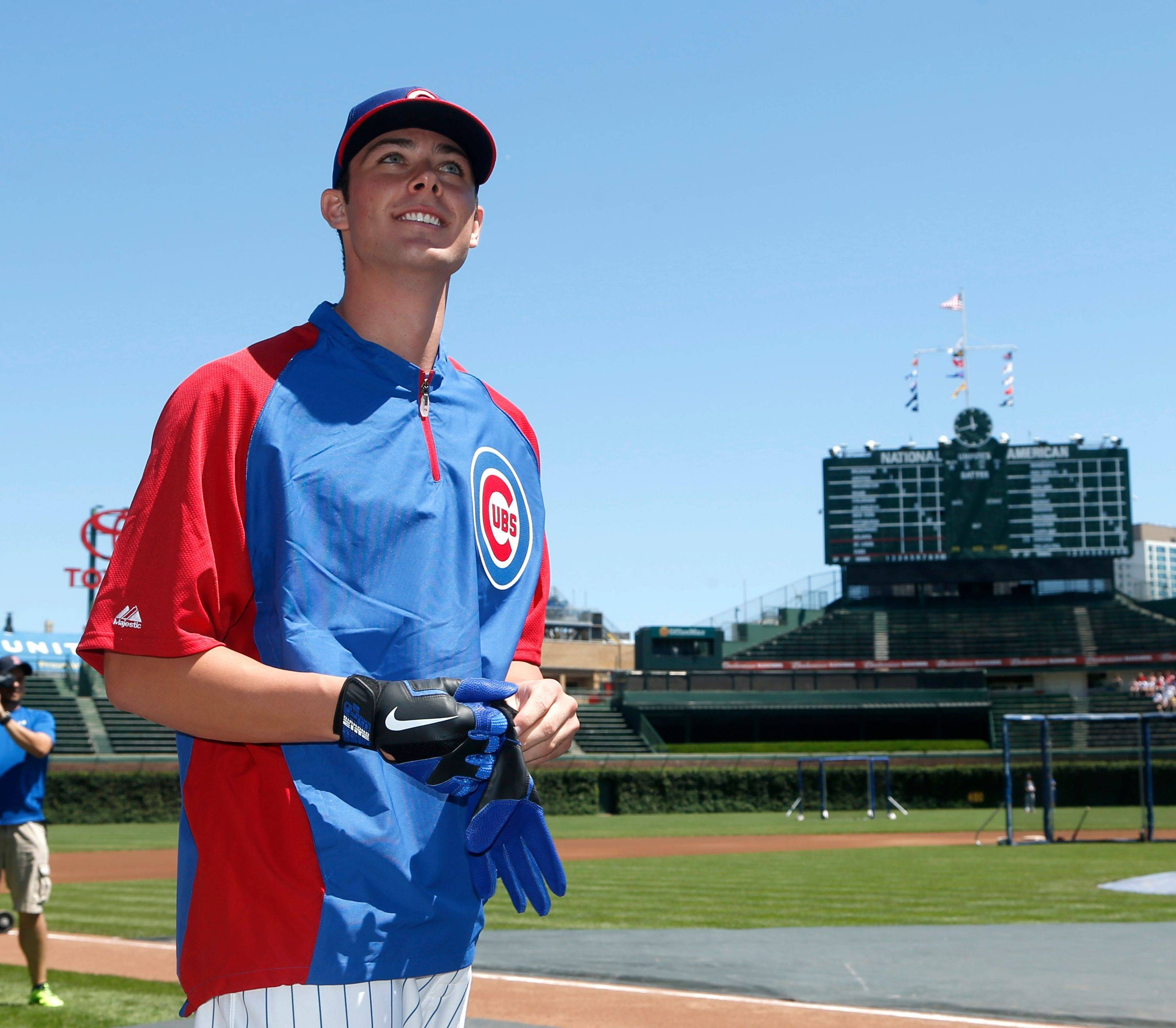 Cubs' first-round draft pick Kris Bryant looks around Wrigley Field before a private batting practice session with manager Dale Sveum before the Cubs played the Cardinals on Friday. At his introductory news conference, Bryant said he's going to do whatever the Cubs ask of him. See story, Page 3.