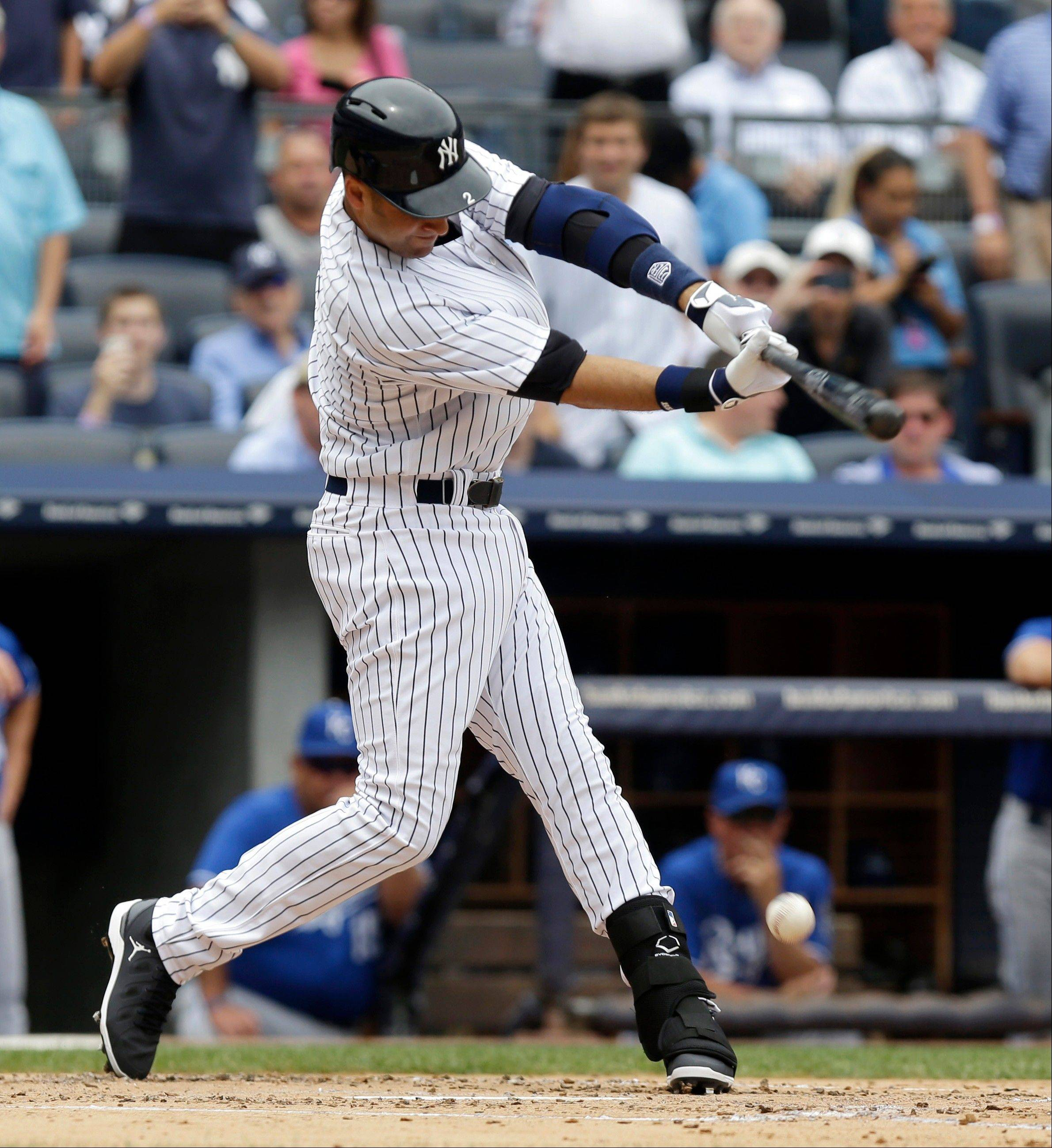 New York Yankees' Derek Jeter singles during the first inning of the baseball game against the Kansas City Royals at Yankee Stadium on Thursday, July 11, 2013, in New York. (AP Photo/Seth Wenig)