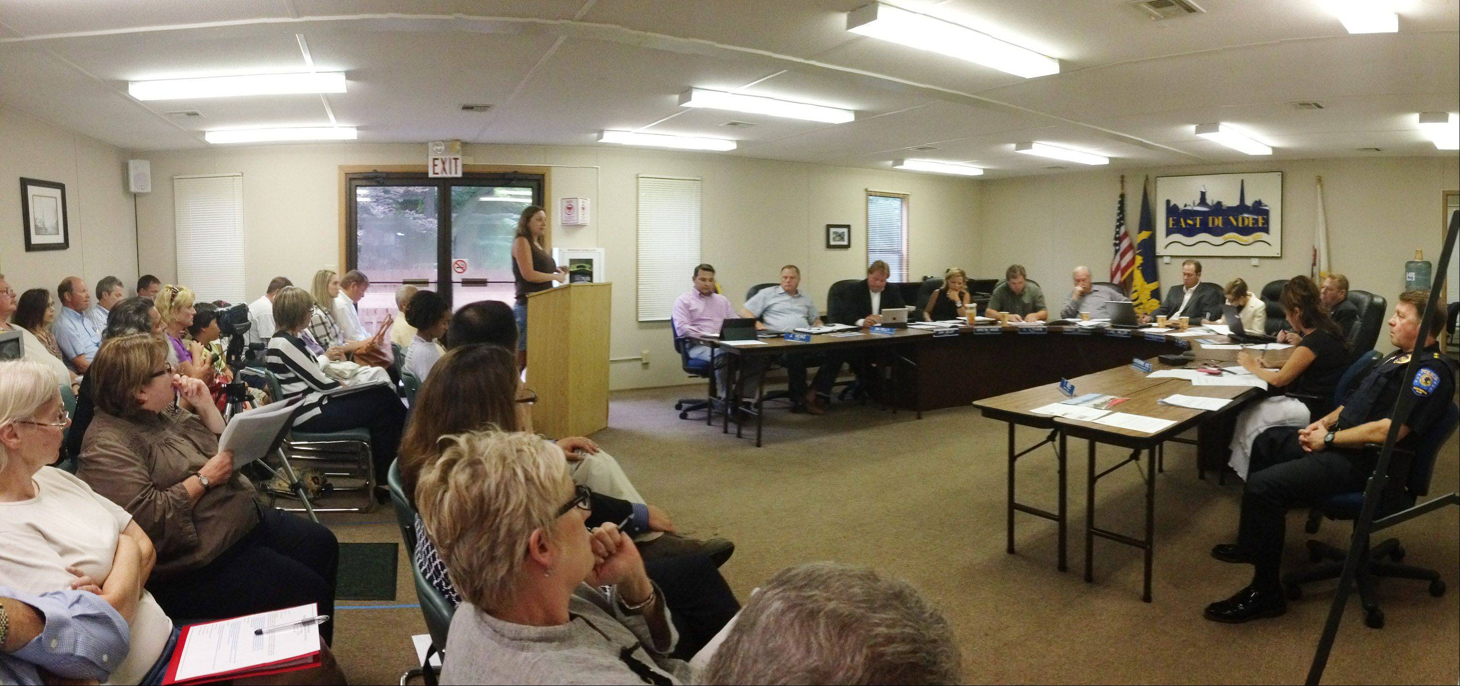 Only four Barrington Hills residents spoke during the East Dundee village board meeting Monday night in which the village approved a redevelopment agreement and industrial subdivision plan for Insurance Auto Auctions. Barrington Hills residents fear IAA, which will do business on the border of the two villages, will pollute their drinking water and urged the board to vote no.