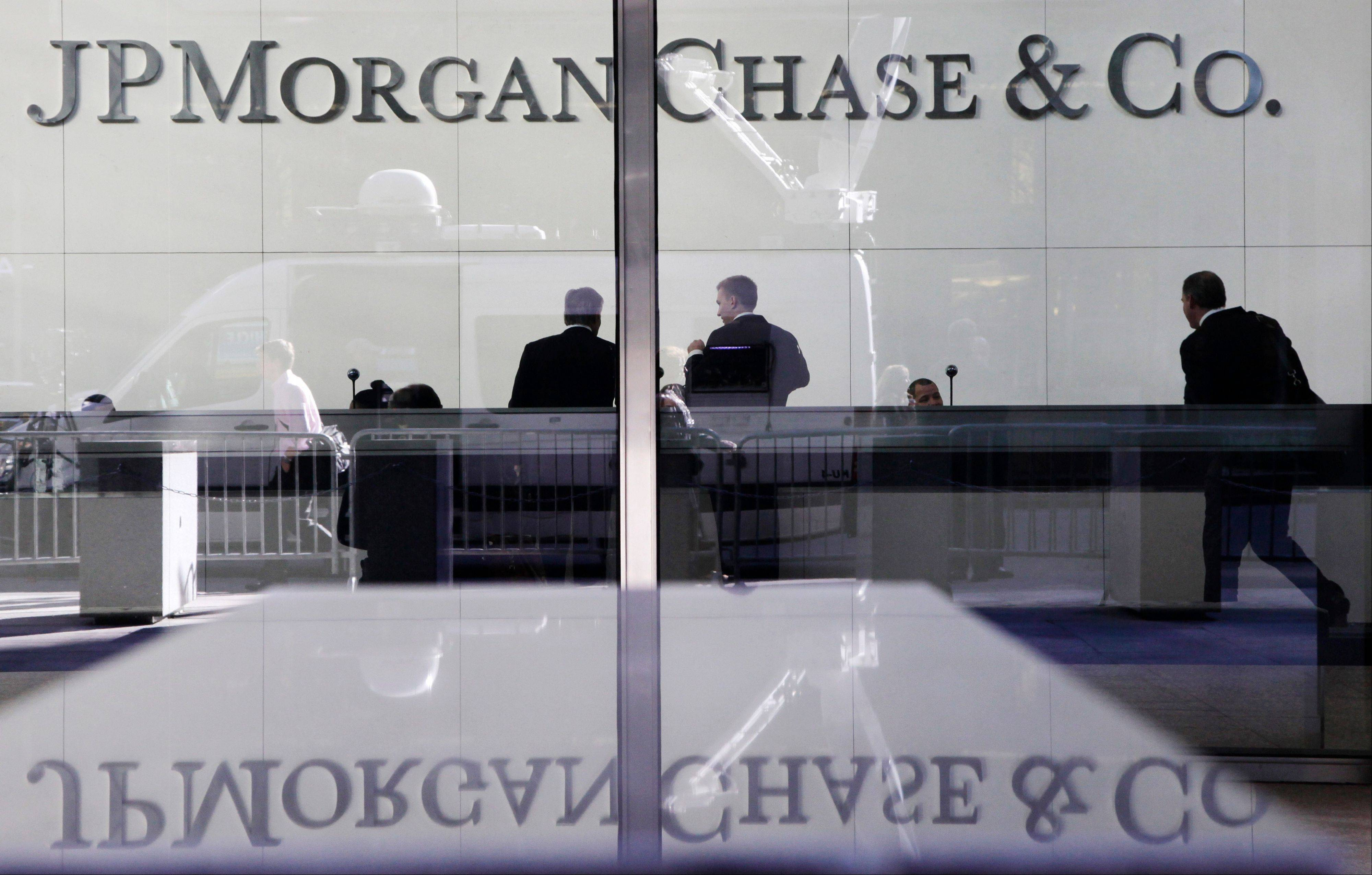 JPMorgan Chase, the biggest U.S. bank, says its second-quarter earnings surged from a year ago as profits from investment banking grew.