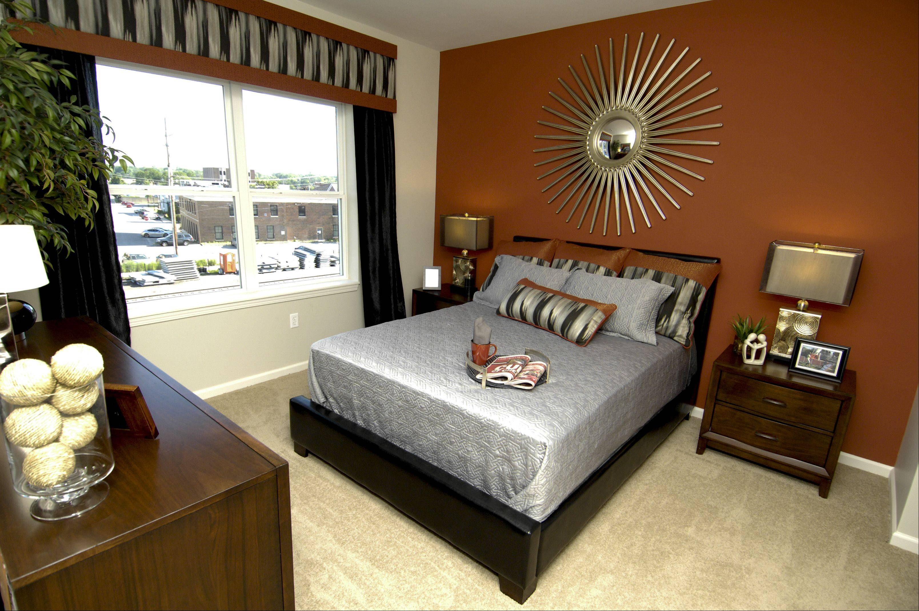 A bedroom in one of the model apartments at Wheaton 121 during a preview of its nearly completed high-end apartment building, Thursday.