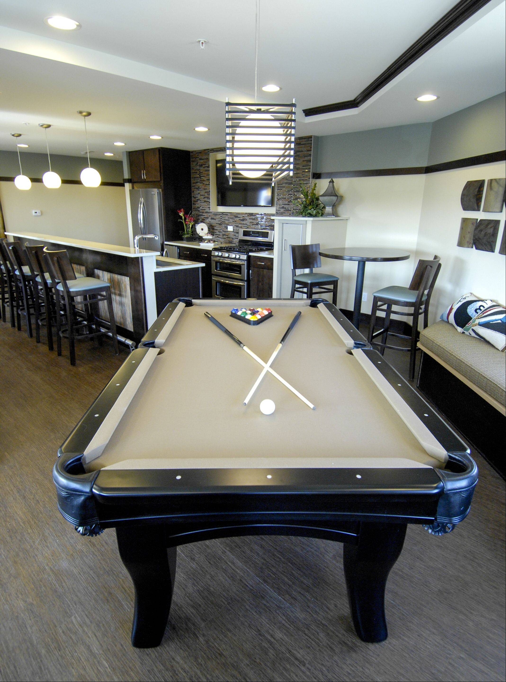 Wheaton 121 has a common room that residents can reserve to use for their own private parties that includes a pool table, full kitchen, fireplace and TVs.