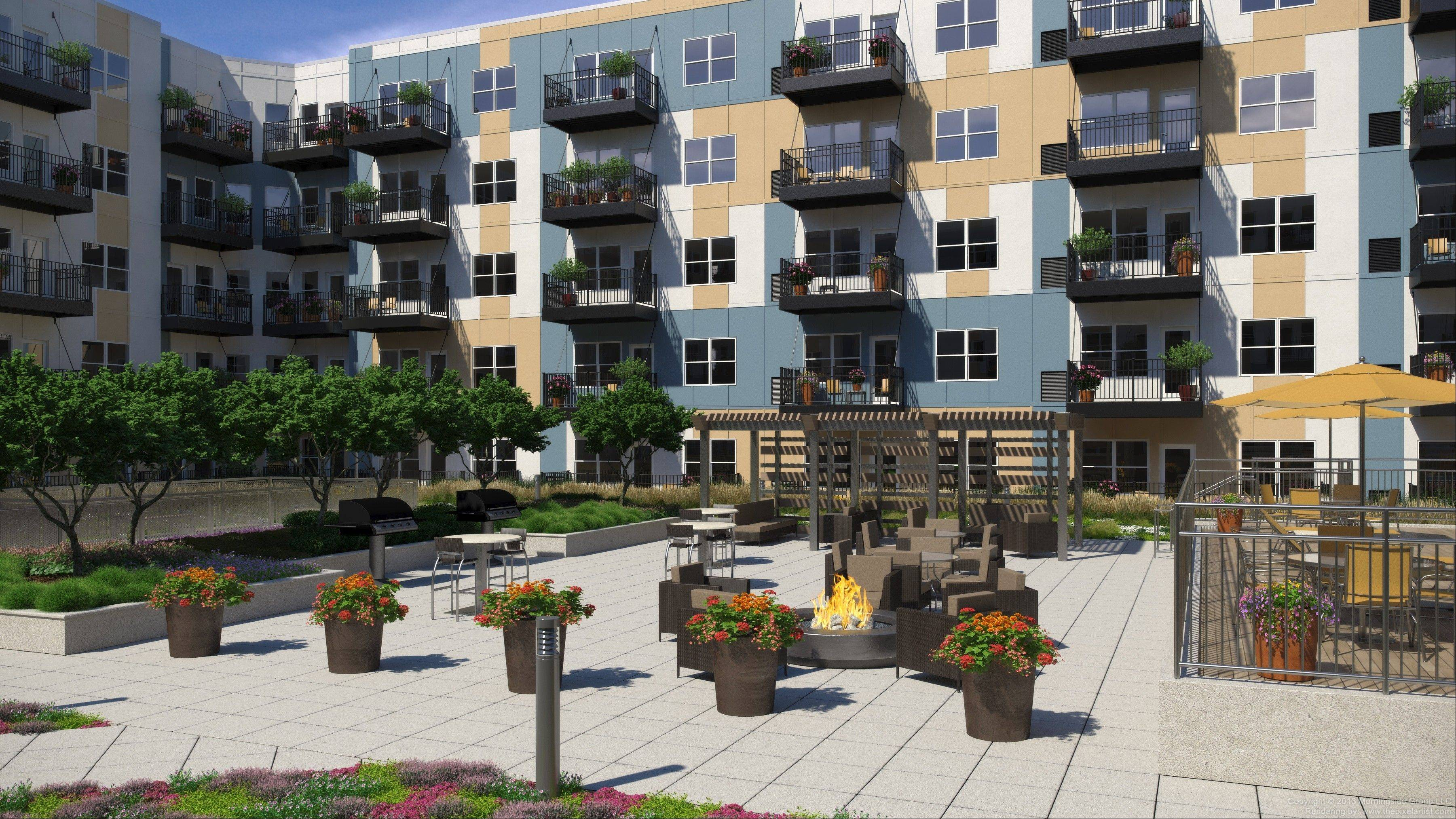 The outdoor grill and common area are just two of the luxury amenities ready for guests next spring.