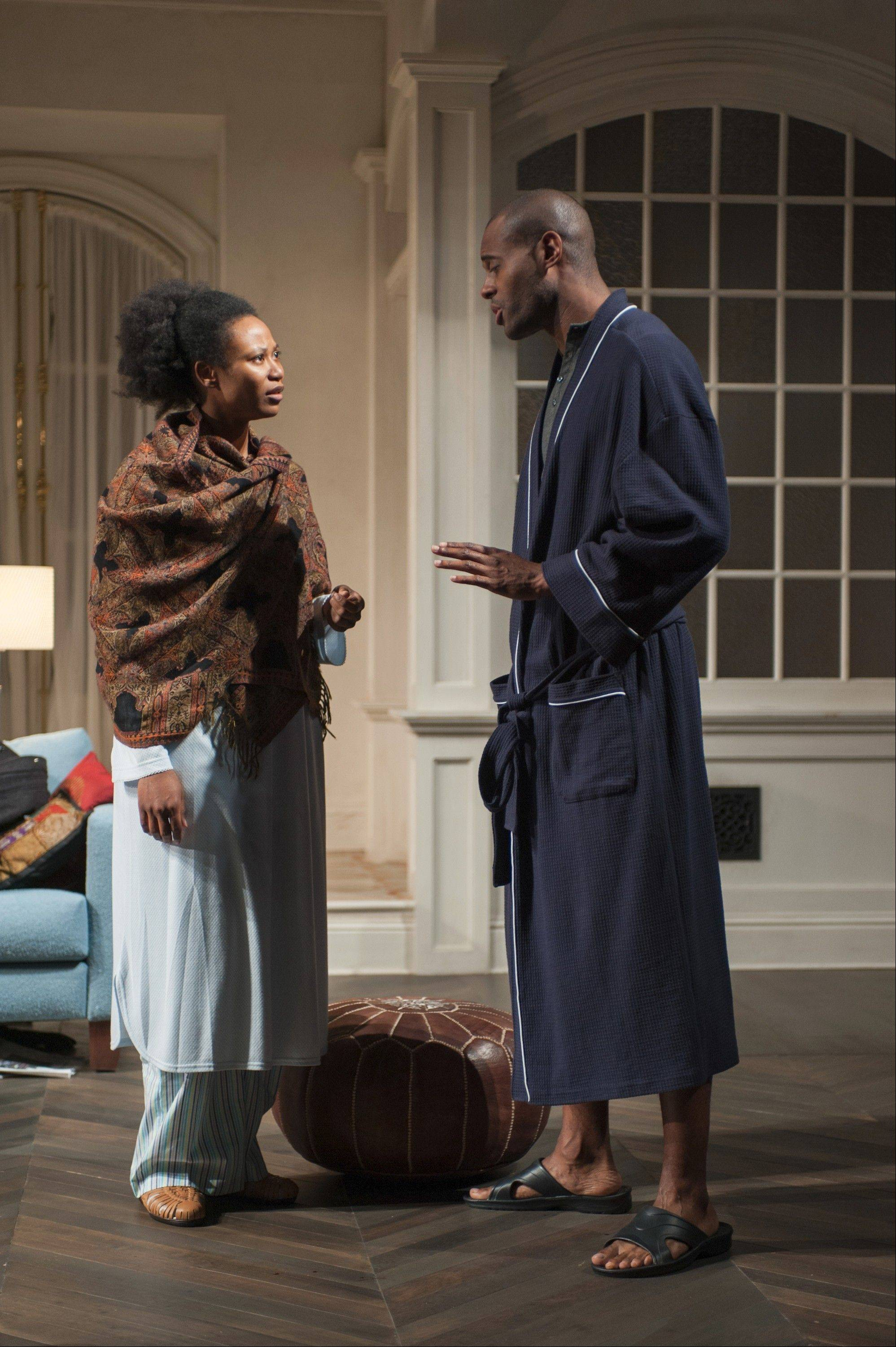 "Alioune (Chris Boykin, right) reassures his wife Amina (Alana Arenas) about their seemingly erratic tenants Abby and Zack in Steppenwolf Theatre's Chicago area premiere of Amy Herzog's ""Belleville."""
