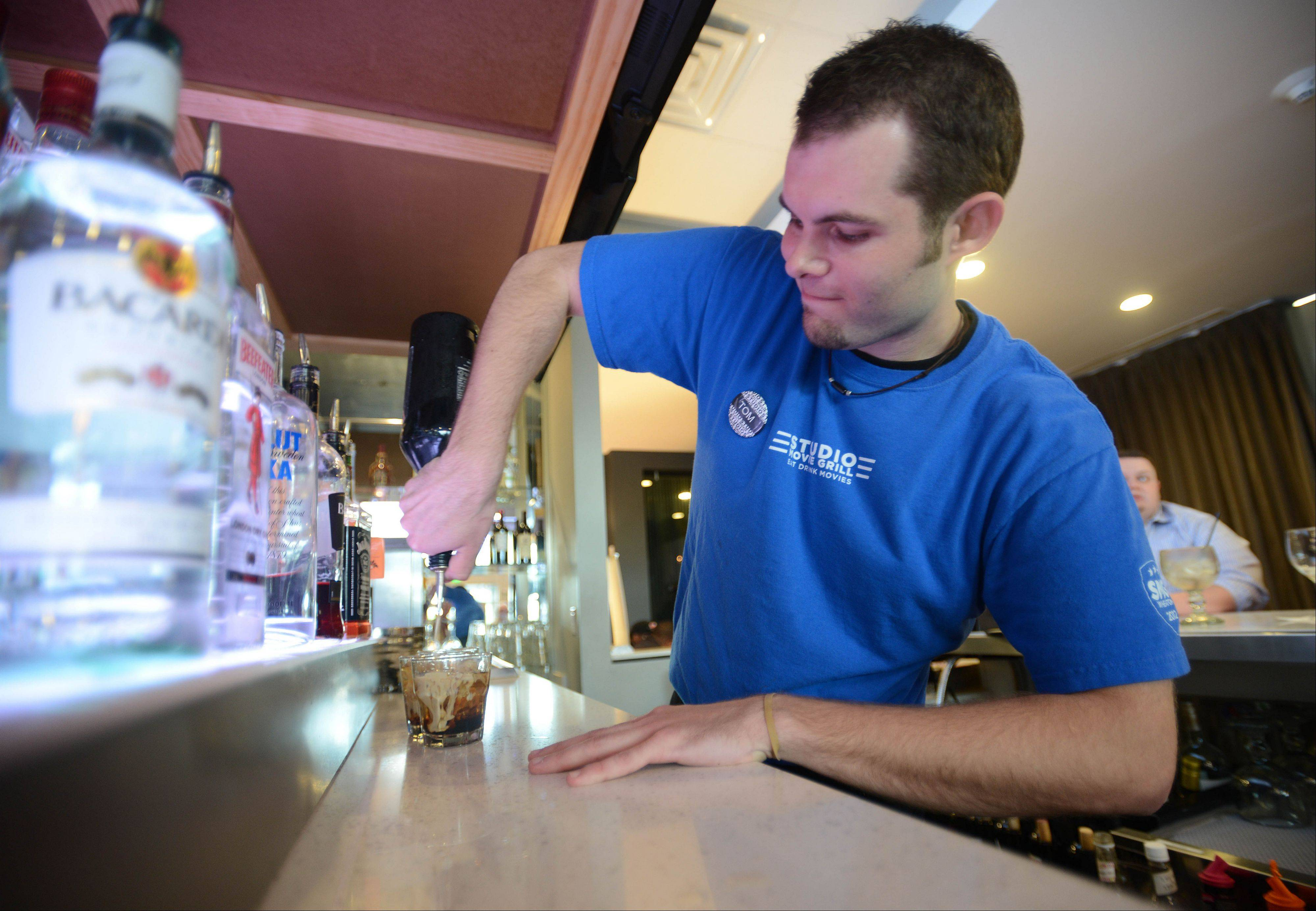 Thomas Sweeney pours a drink at Studio Movie Grill.