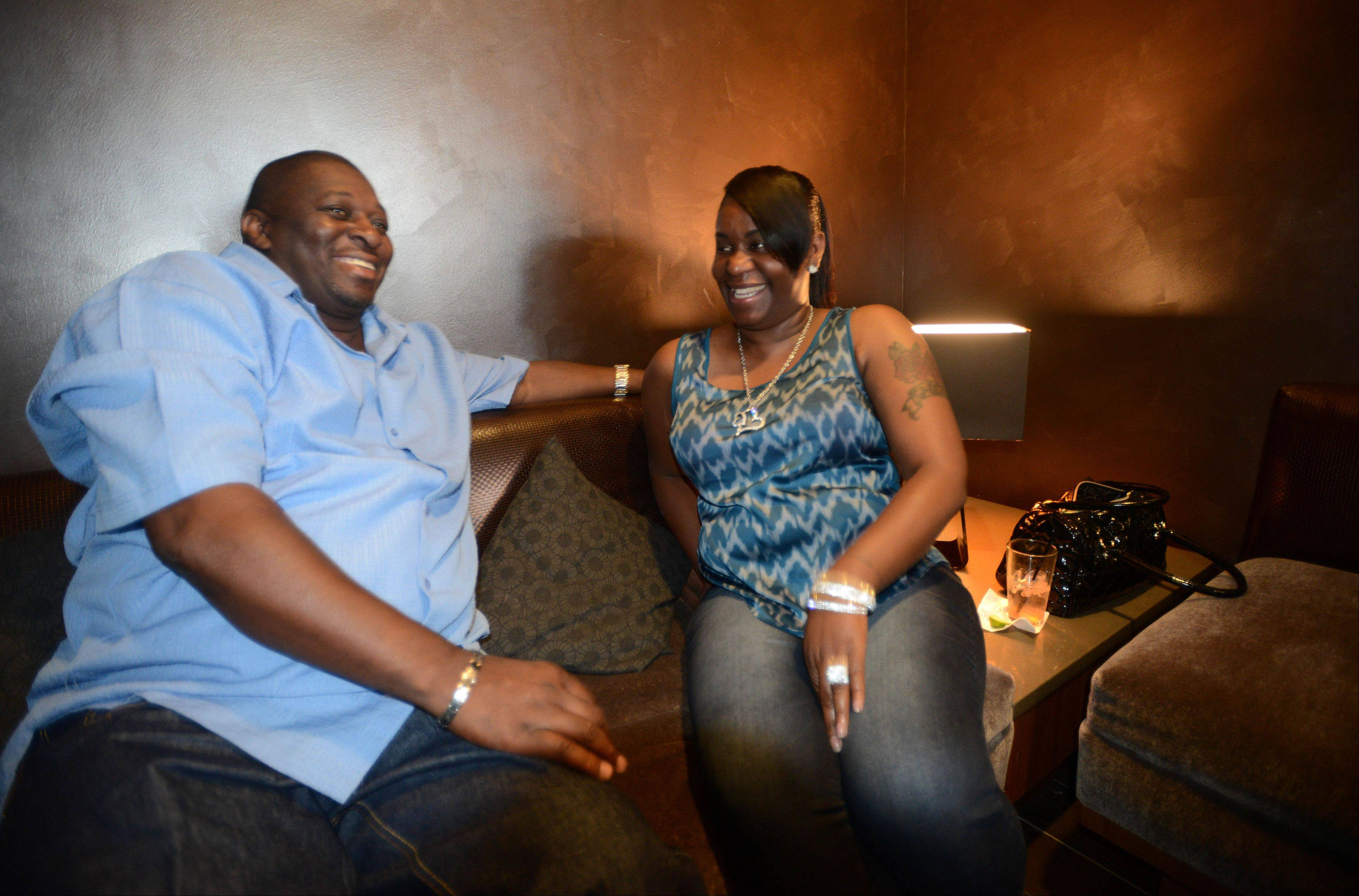 Westley Spruill and Teneka Ware share a laugh at Studio Movie Grill in Wheaton.