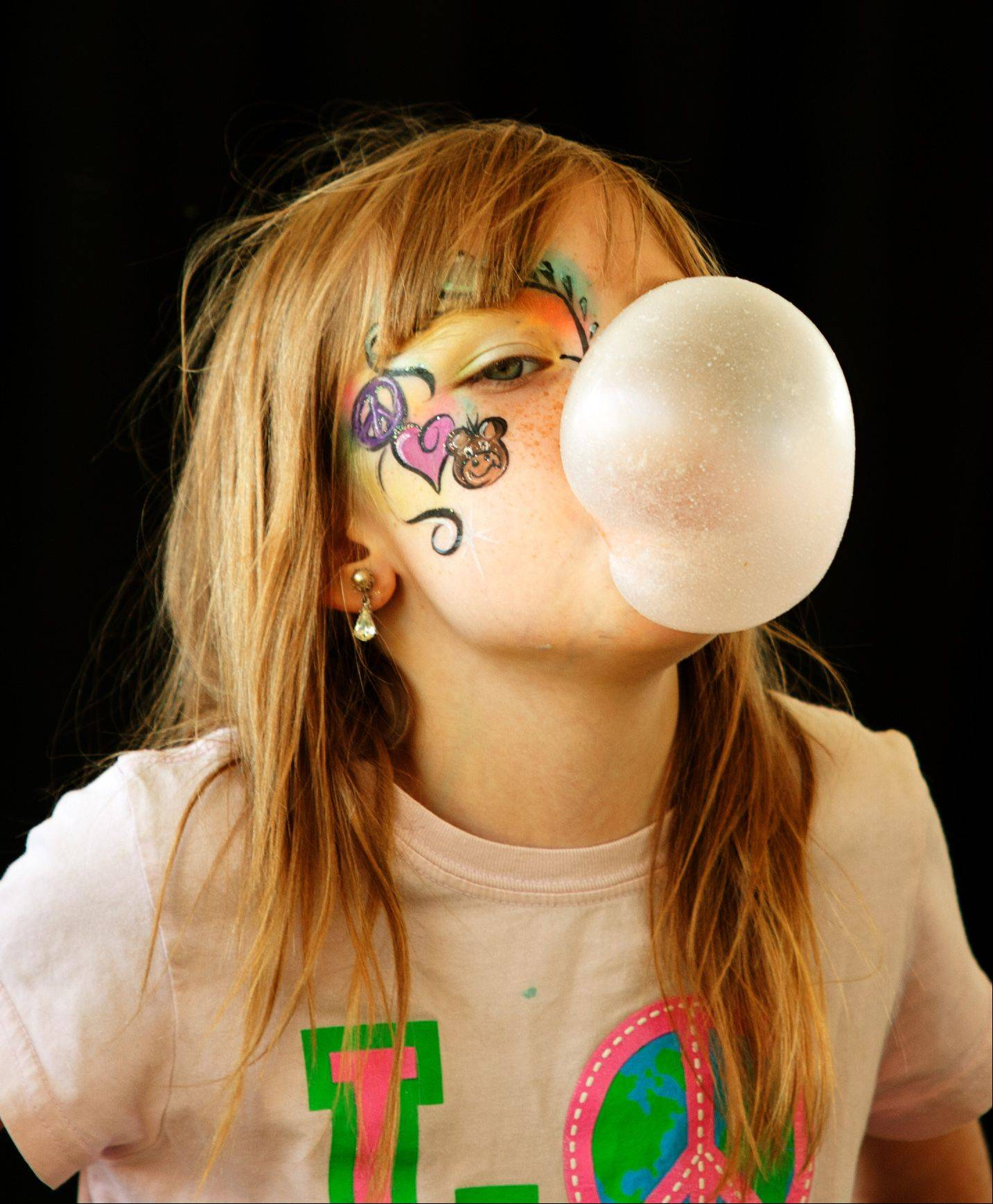 Rianna Culp, 9, of Crystal Lake wins a bubble gum blowing contest during Itascafest on Saturday.