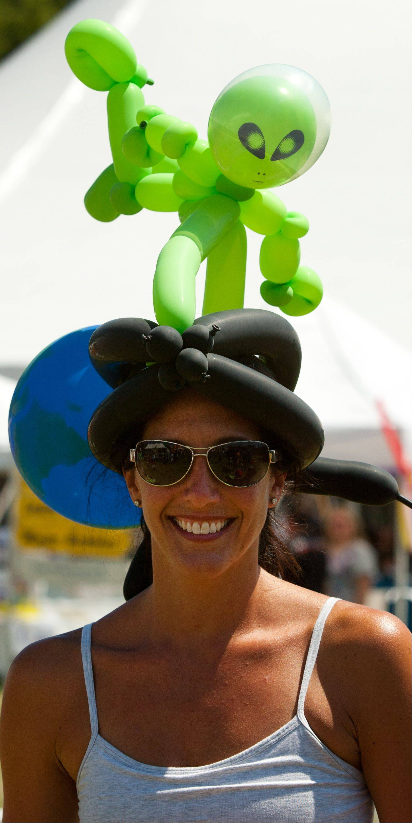 Natalie Brinkley of Itasca enjoys her alien balloon headdress during Itascafest on Saturday.
