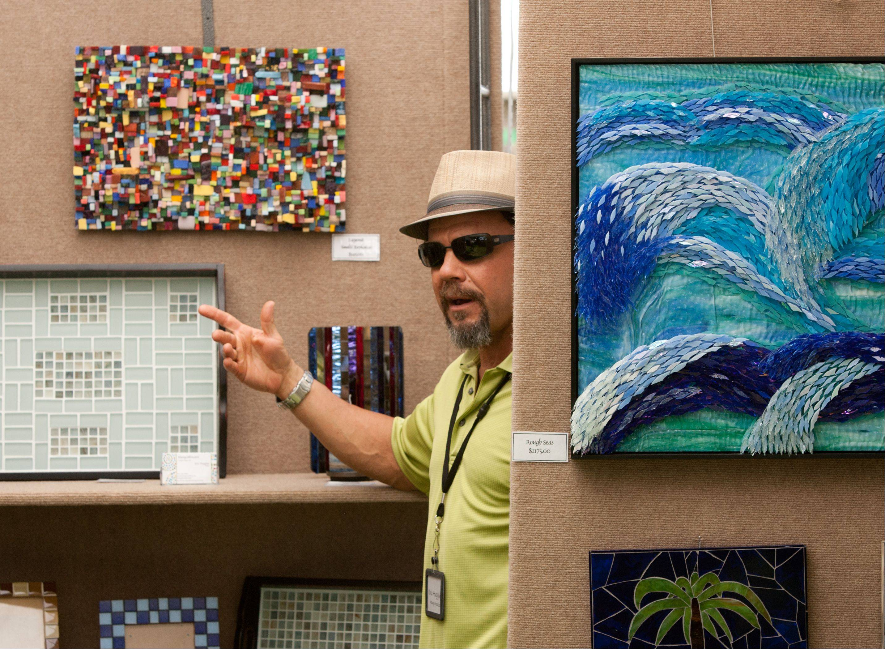 Eric Huggins of Mango Mosaics in Bourbonnais talks about his glass mosaics during the Naperville Woman's Club Fine Art Fair on Saturday.