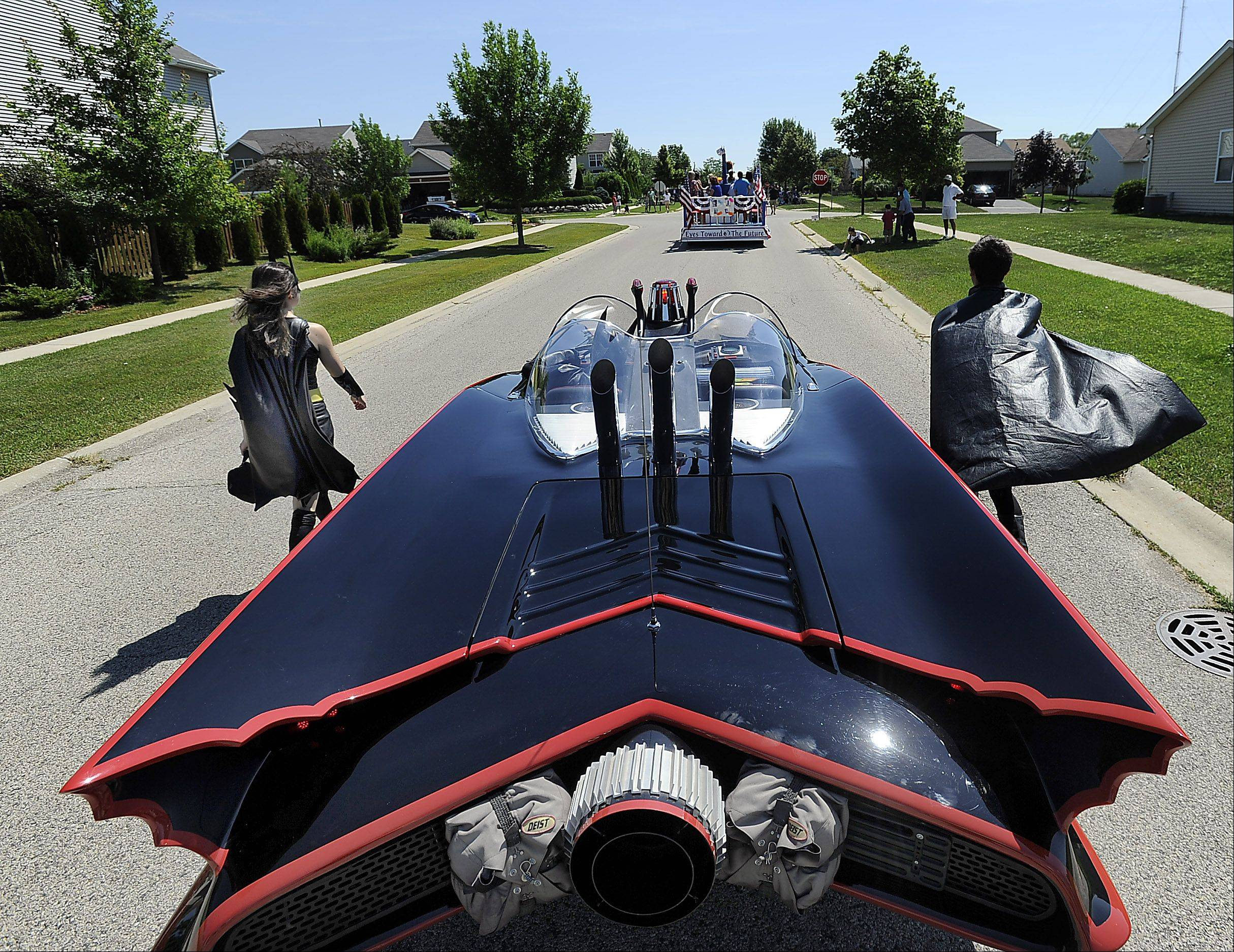 Round Lake Heights Trustee Dominick Mahoney drives the Batmobile in the Round Lake Heights Festival parade Saturday, July 13. It's a fan favorite at the event.