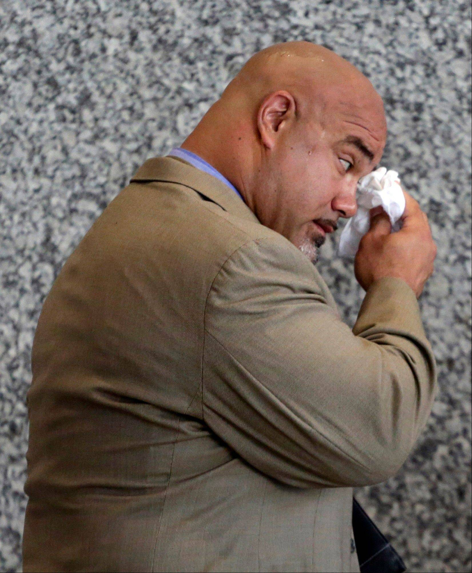 Ex-Bear Chris Zorich enters federal court Friday in Chicago for his sentencing.