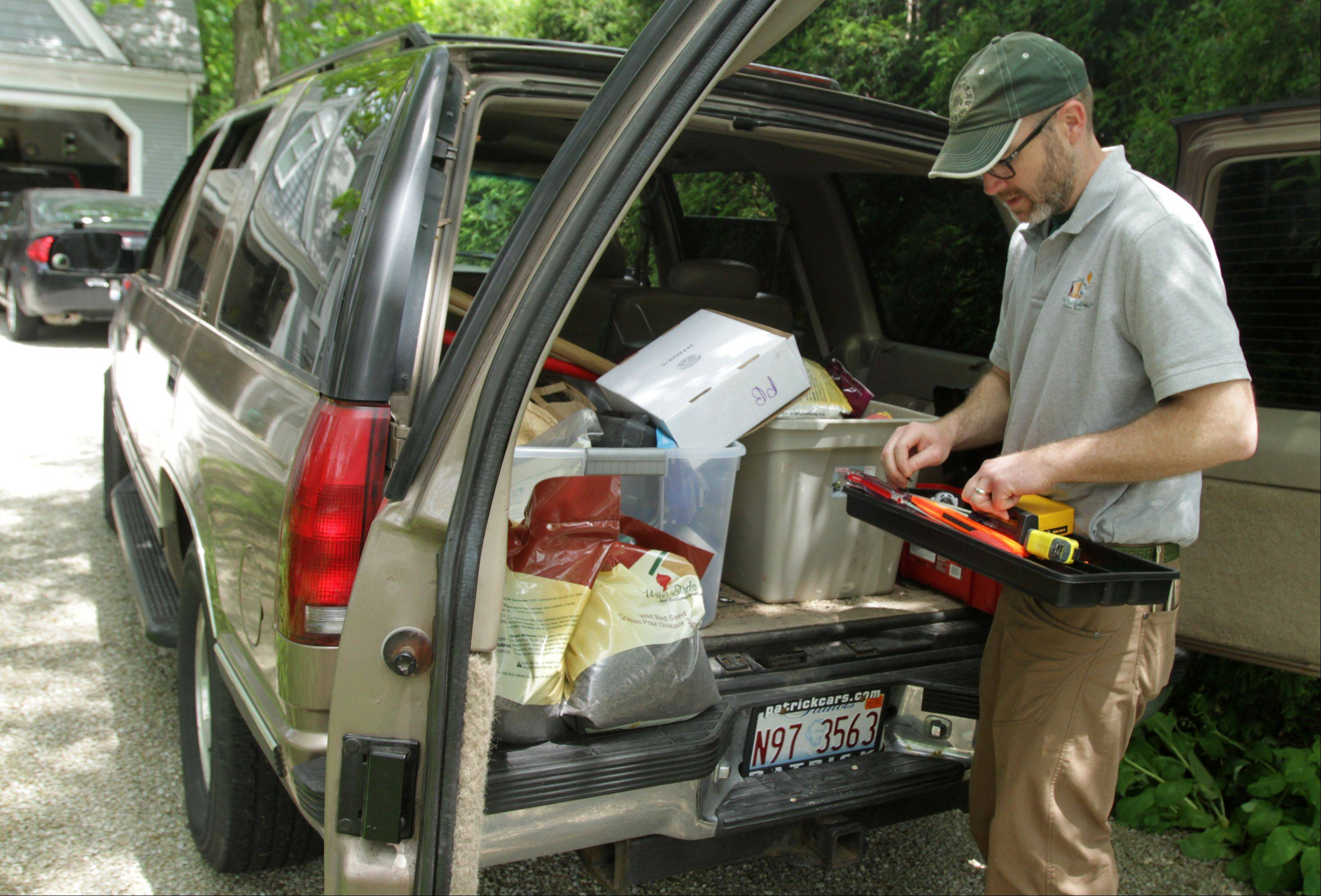 Tim Joyce maintains a variety of bird seed, suet and nuts to fill feeders, along with a toolbox for repairing and installing bird houses, feeders and poles as he travels throughout Cook and Lake counties visiting customers.