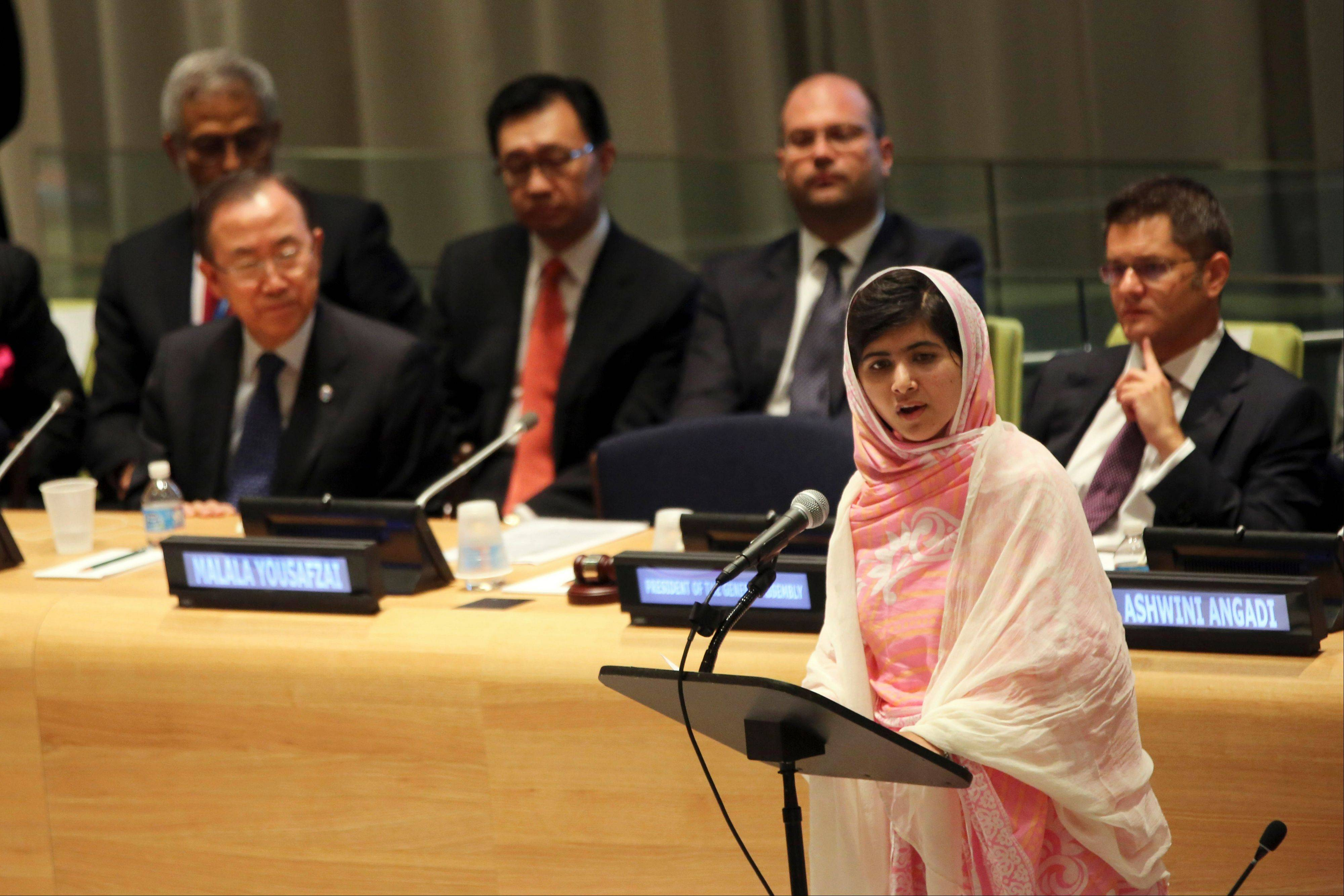 "United Nations Secretary-General Ban Ki-moon, left, listens as Malala Yousafzai, right, addresses the ""Malala Day"" Youth Assembly, Friday, July 12, 2013 at United Nations headquarters. Malala Yousafzai, the Pakistani teenager shot by the Taliban for promoting education for girls, celebrated her 16th birthday on Friday addressing the United Nations."