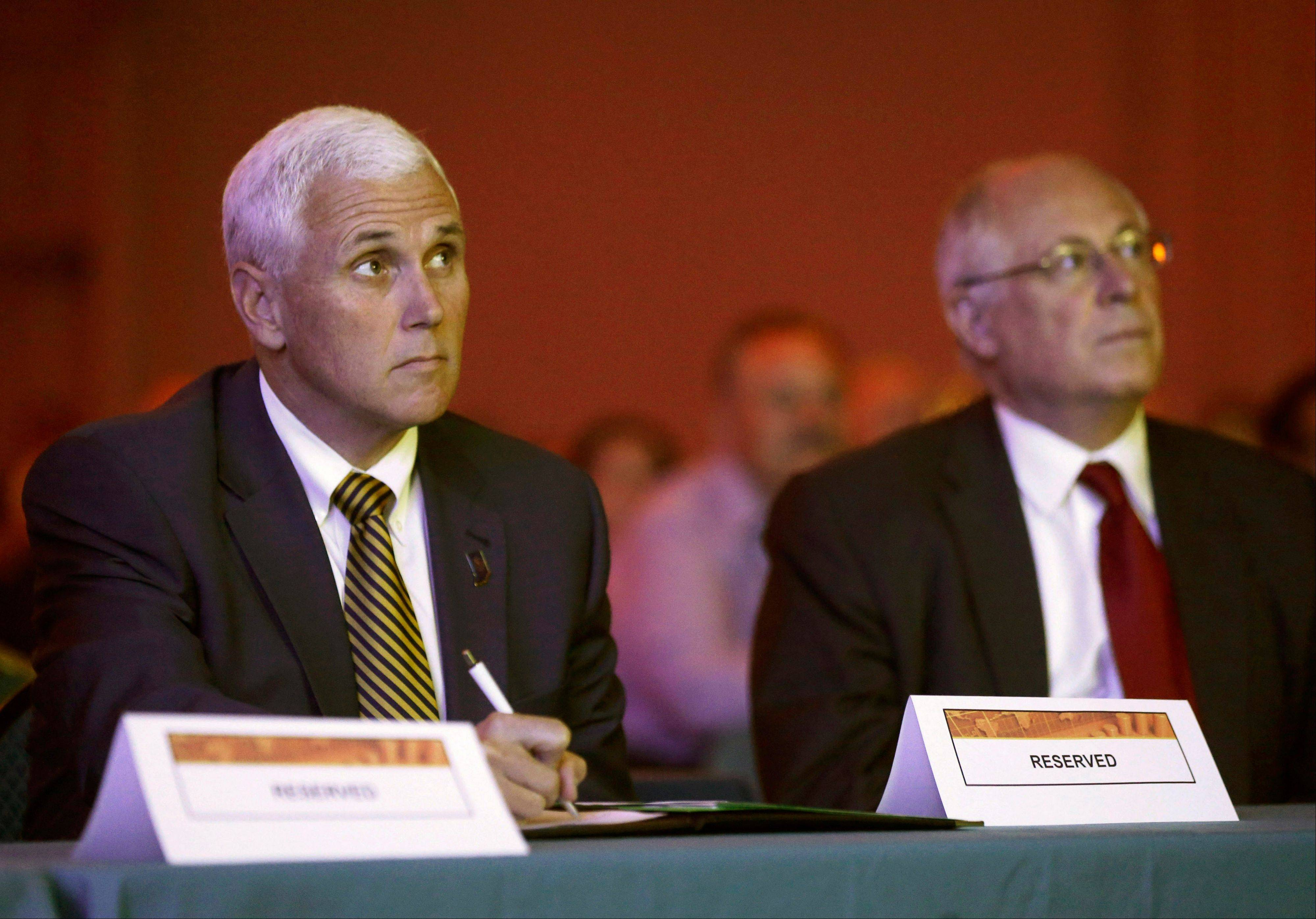 Indiana Gov. Mike Pence, left, and Illinois Gov. Pat Quinn watch a video during the Illiana Industry Forum they hosted in June in Rosemont.