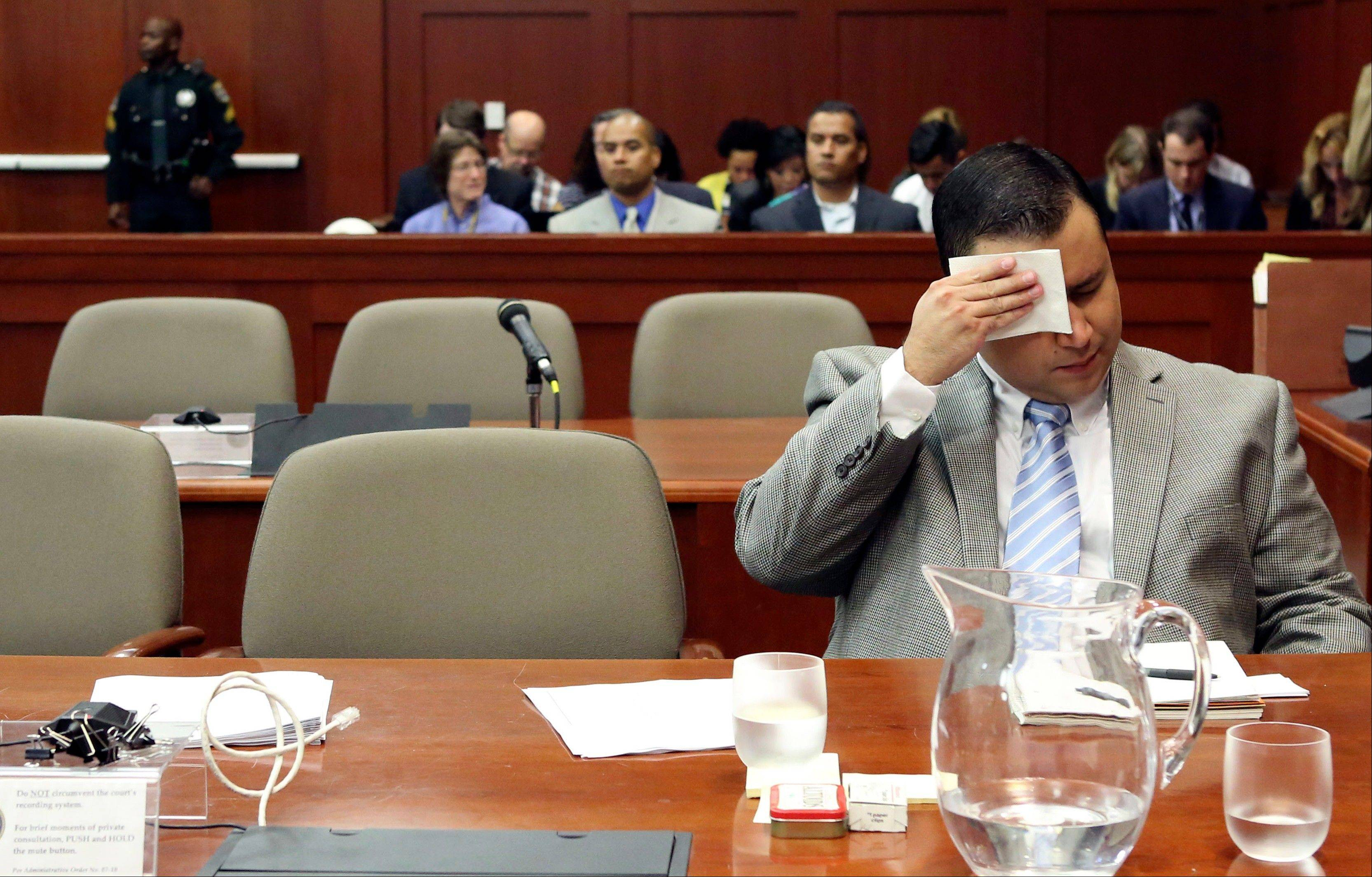 George Zimmerman wipes his brow before the start of court during his trial in Seminole circuit court in Sanford, Fla. Thursday, July 11, 2013. Zimmerman has been charged with second-degree murder for the 2012 shooting death of Trayvon Martin.
